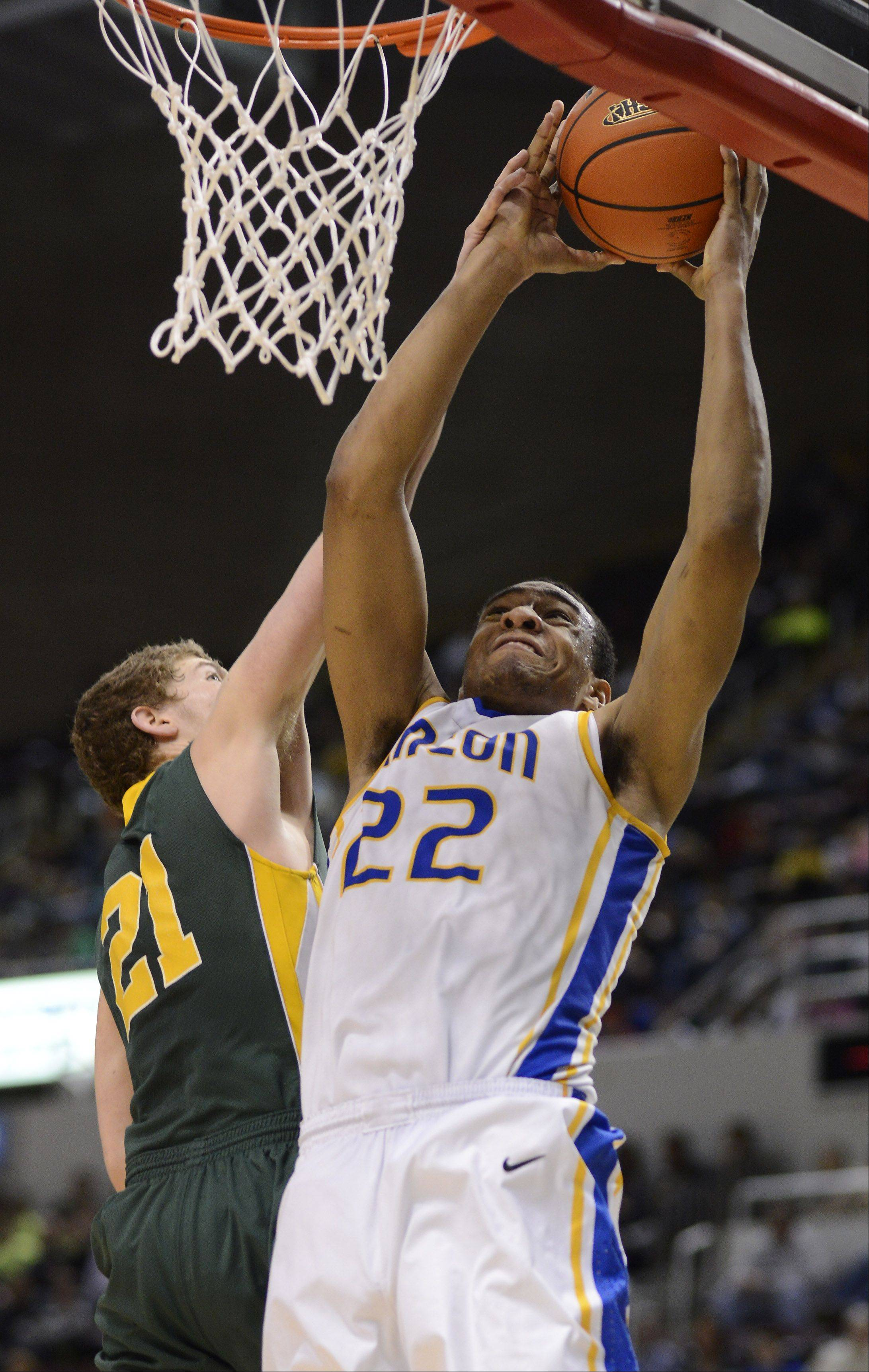 Stevenson's Andrew Stempel, left, tries to stop Simeon's Jabari Parker during the Class 4A boys basketball state finals at the Carver Arena in Peoria Saturday.