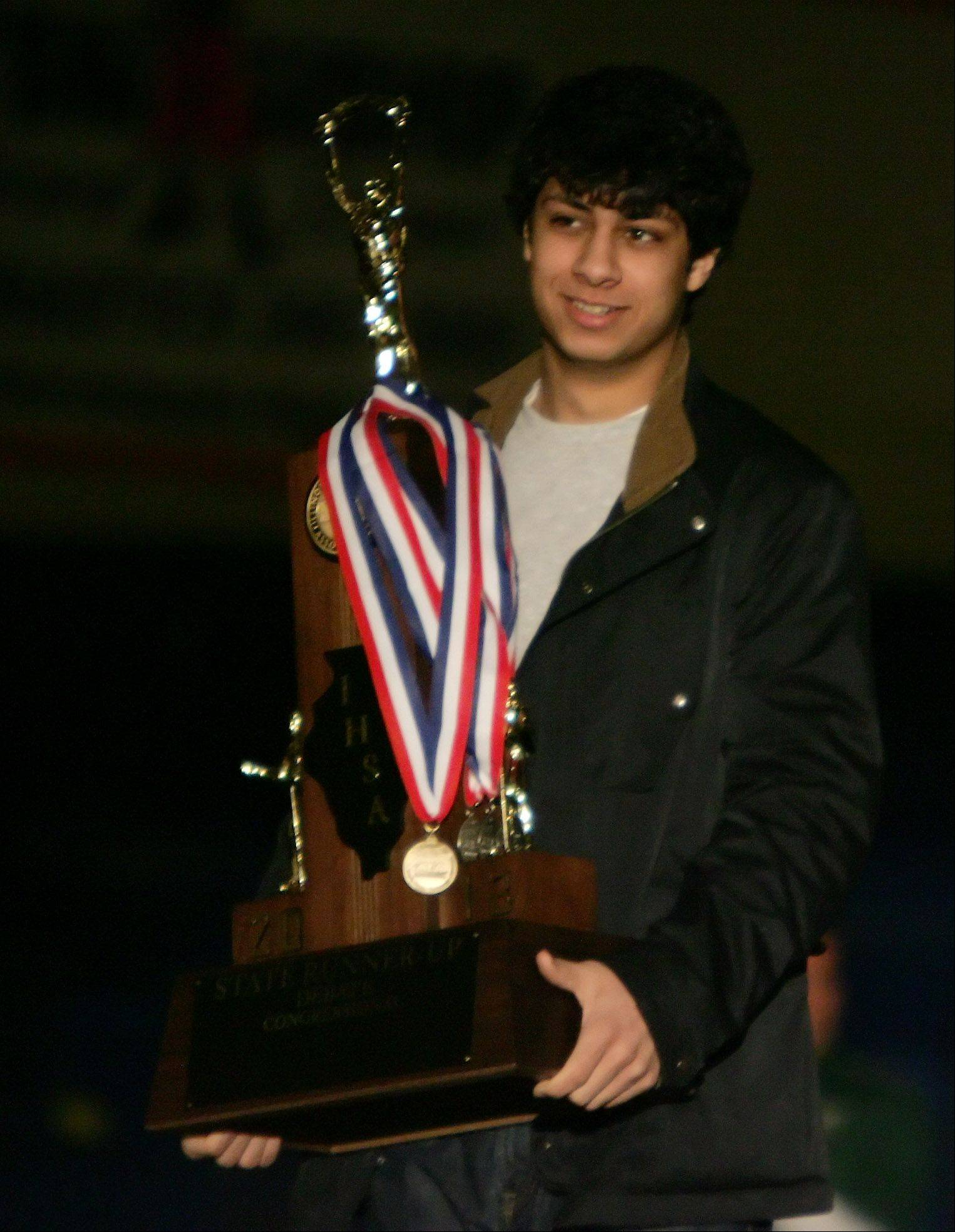 Stevenson High School's Eric Ramoutar holds the second place trophy he won in Congressional debate during a Monday celebration at the school. The team competed in the state IHSA debate tournament at Illinois Wesleyan University in Bloomington.