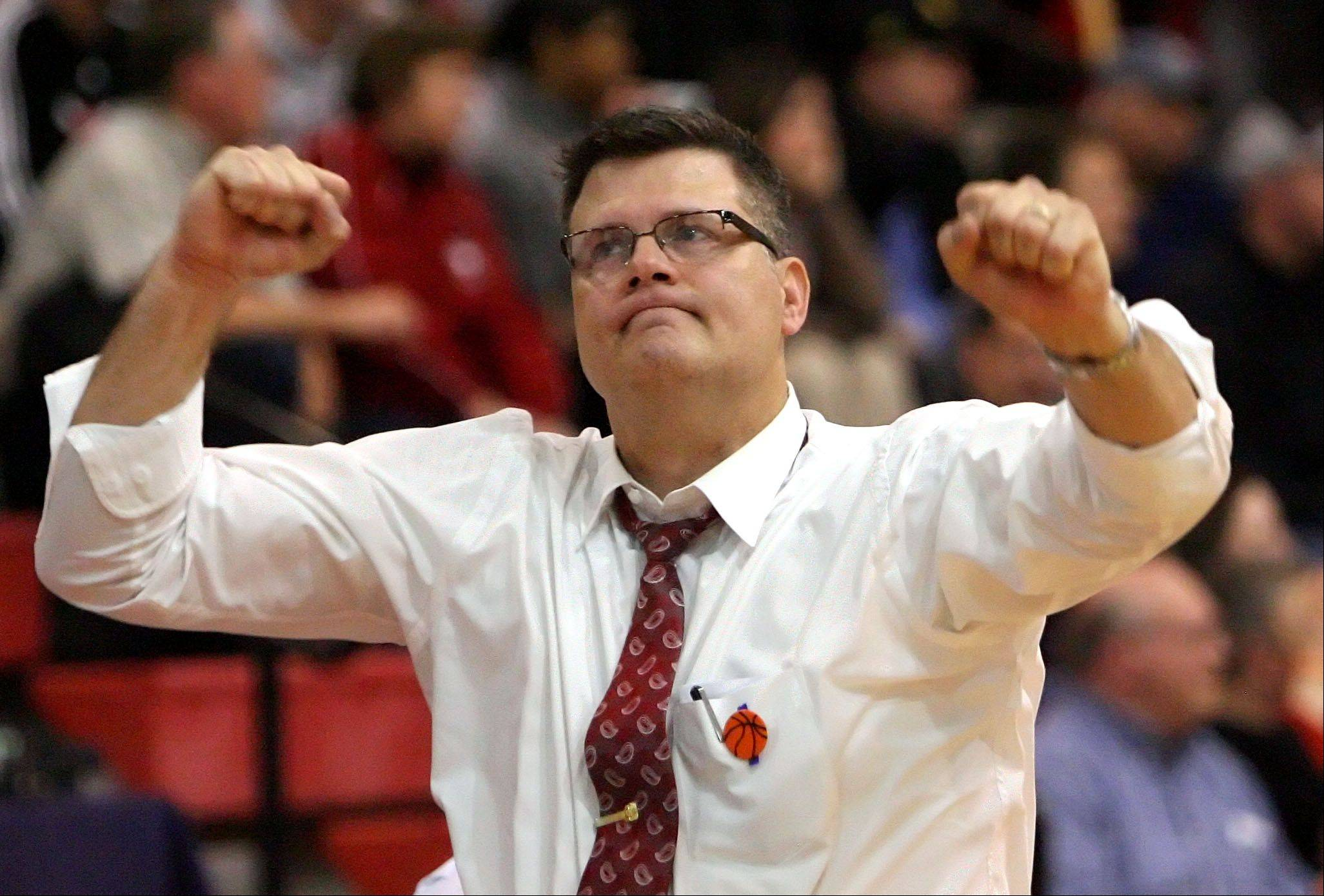 Mundelein's Dick Knar, here celebrating after a sectional semifinal victory, is backing away from coaching at Mundelein.
