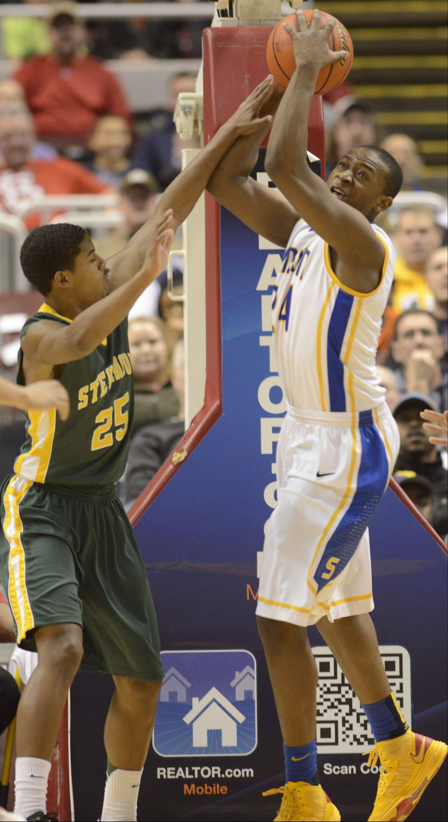 Stevenson's Cameron Green, left, defends Simeon's Kendall Pollard during the Class 4A state championship game Saturday in Peoria.
