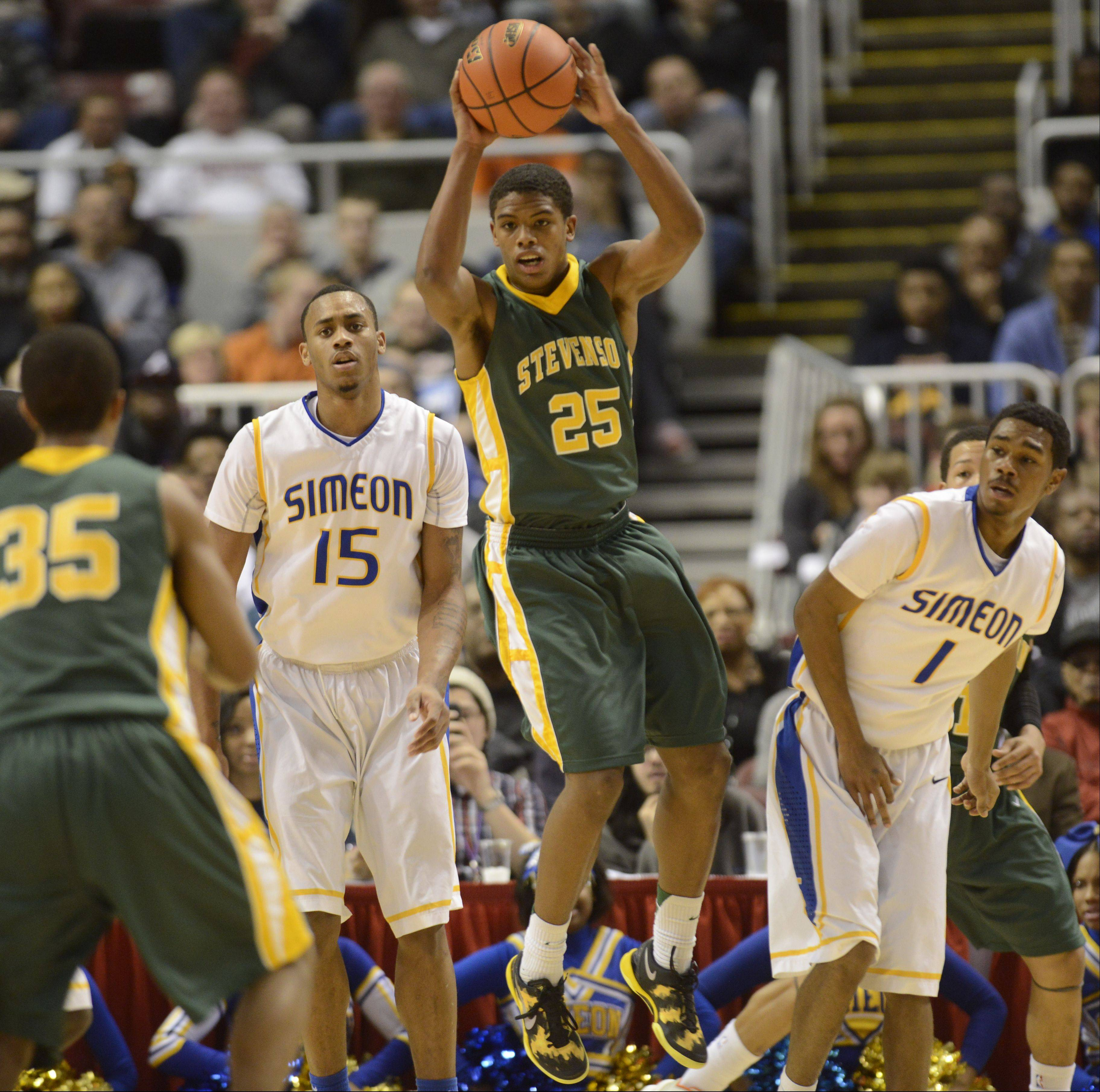 Stevenson sophomore Cameron Green looks to pass the ball during Saturday night's Class 4A state championship game against Simeon.