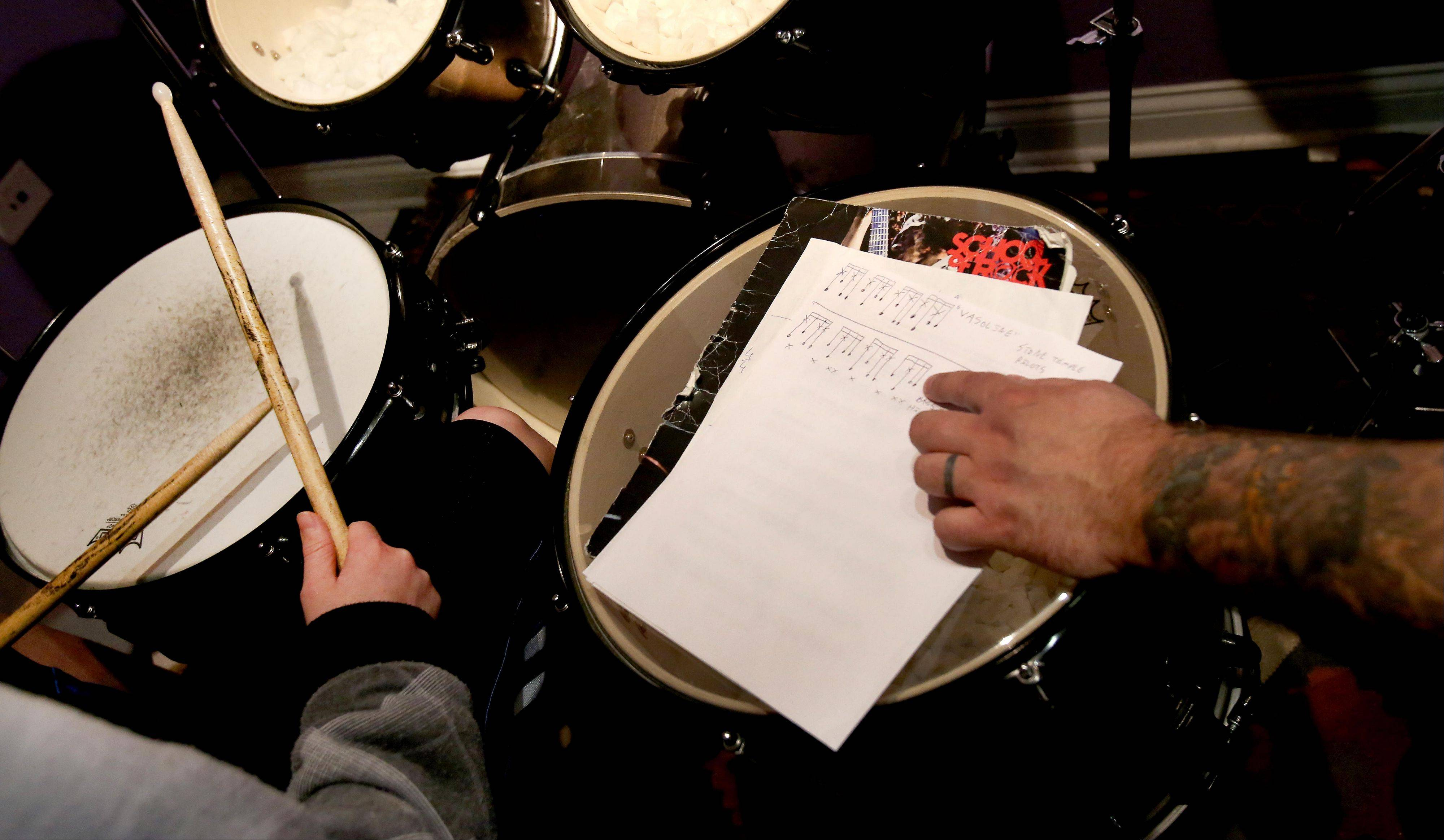 Moving Picture: Rock drummer teaches youngsters his craft