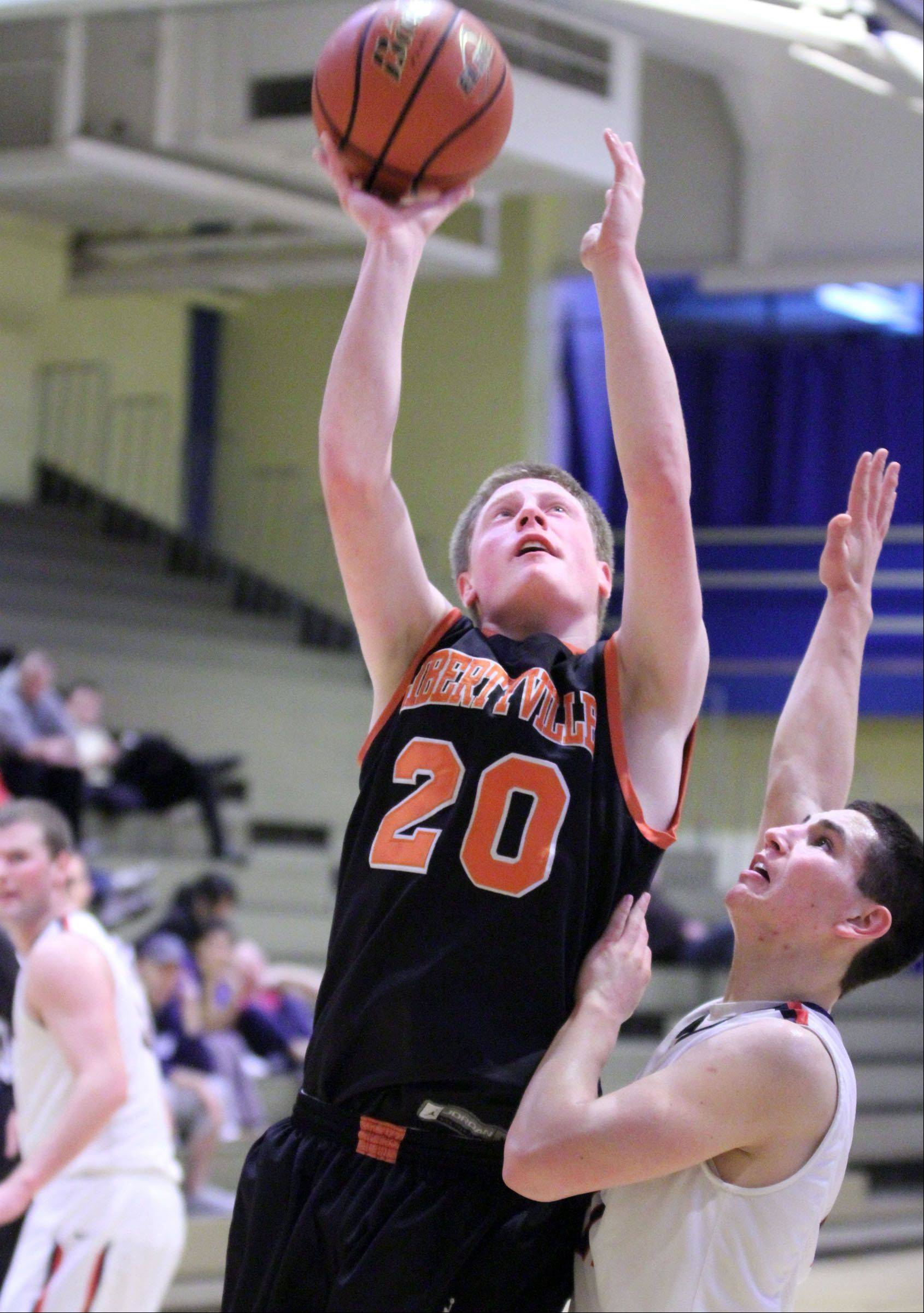 Libertyville's Jack Lipp shoots over St. Viator defender Mark Falotico winter at Wheeling.