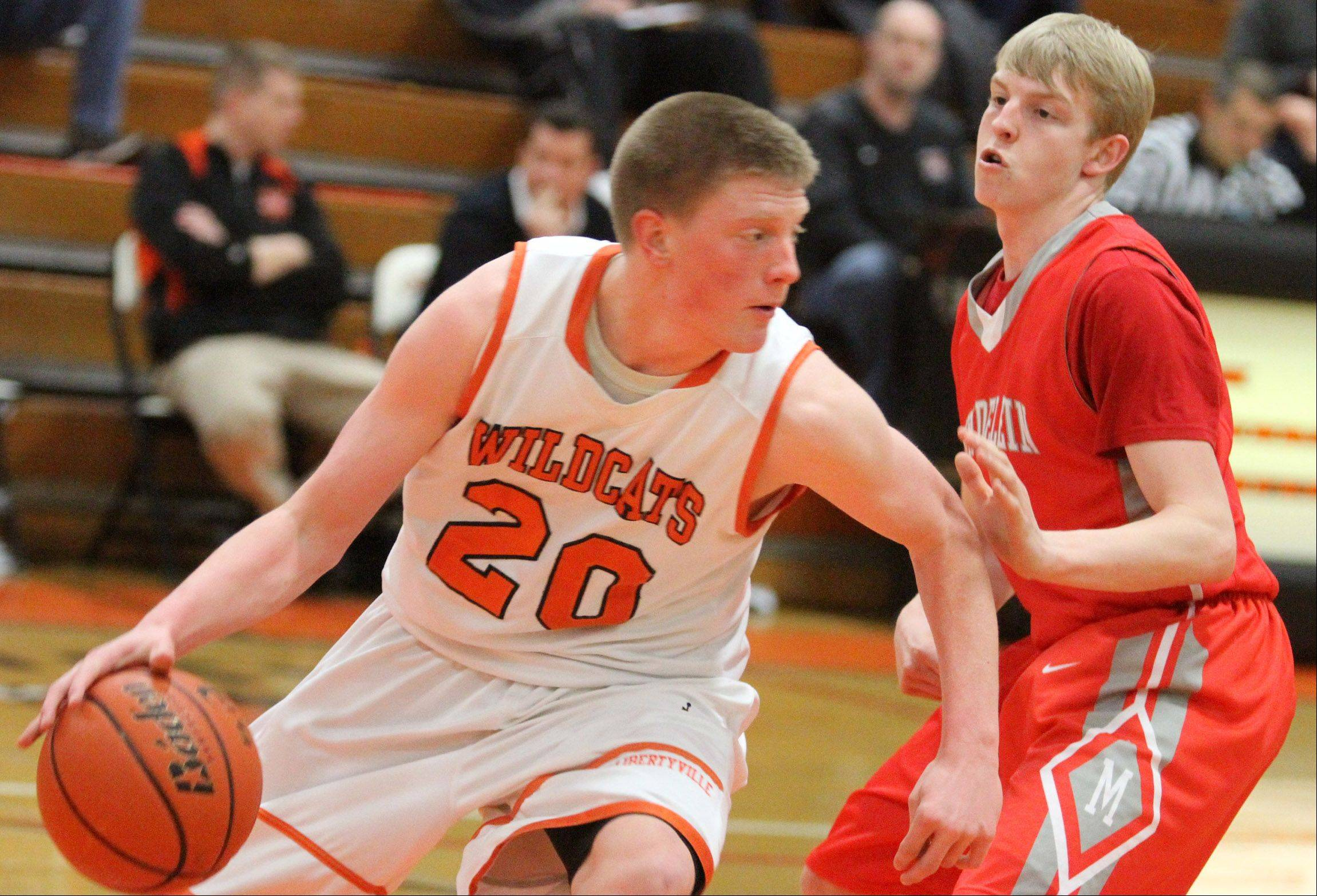 Libertyville guard Jack Lipp looks for running room after grabbing a defensive rebound against Mundelein at Libertyville in February.