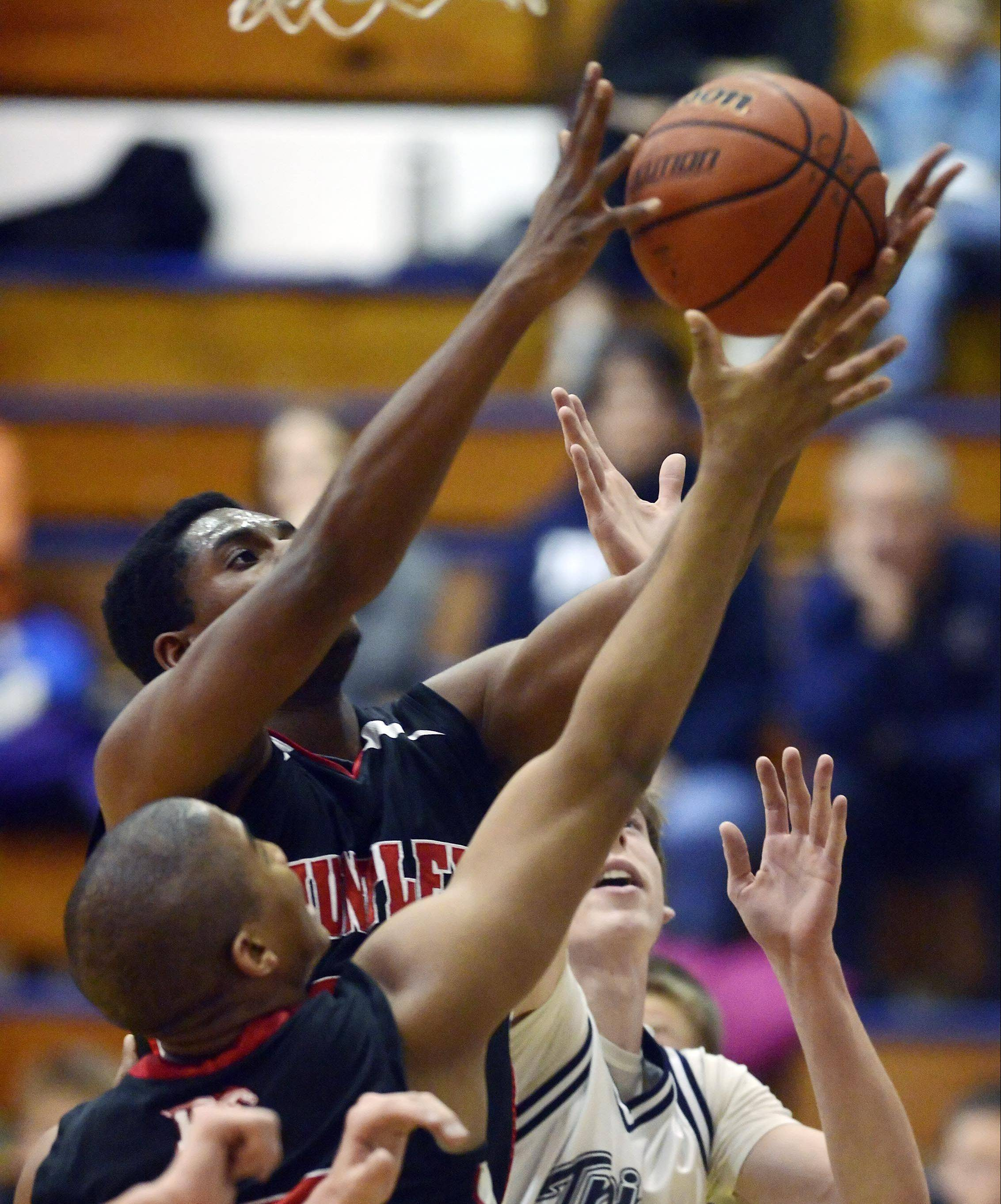 Huntley's Amanze Egekeze rises up for a rebound next to teammate Bryce Only and Cary-Grove's Dean Lee last season at Cary-Grove. Egekeze has committed to a collegiate future at Belmont University in Nashville, Tenn.