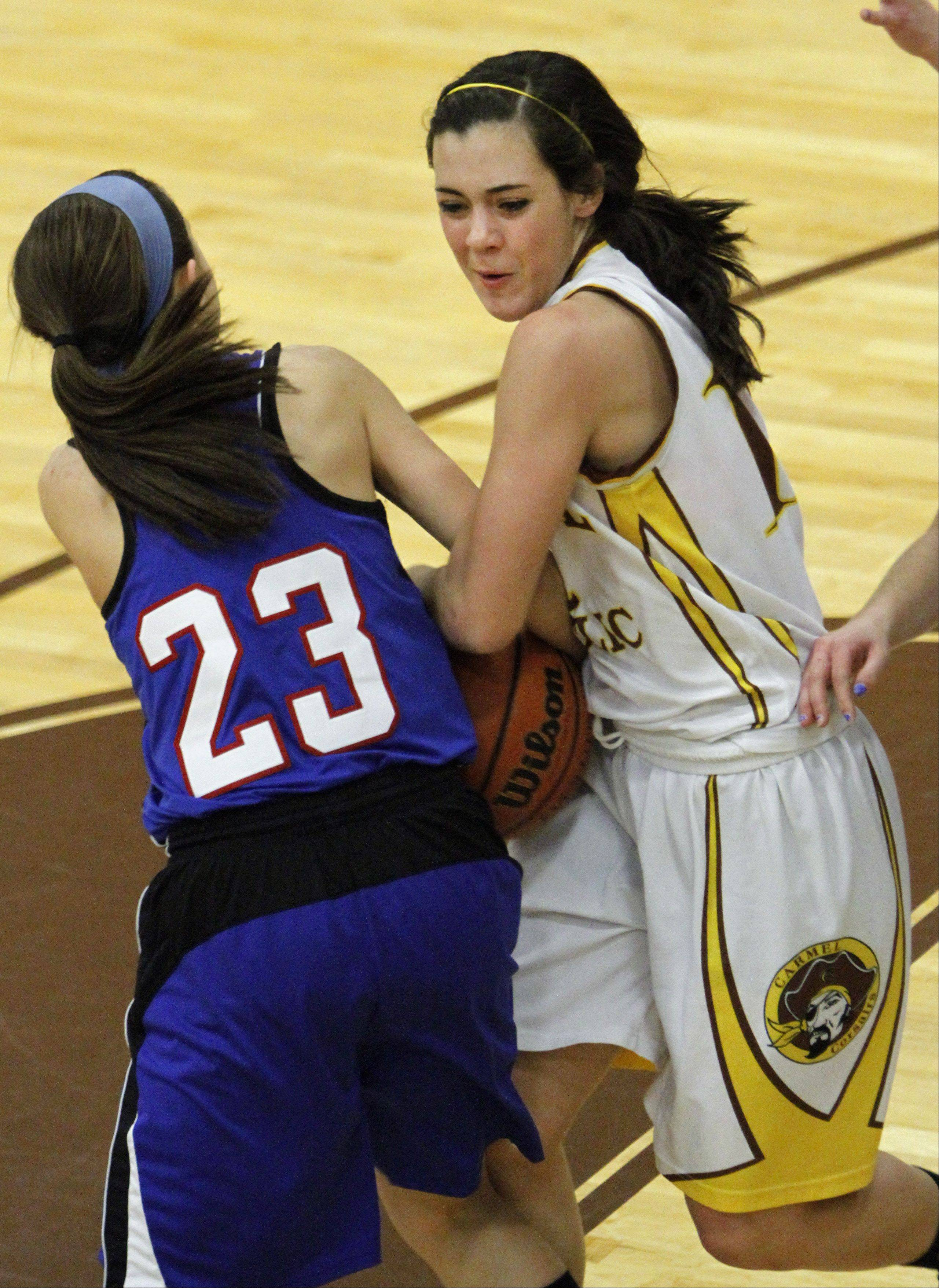 Carmel's Kathleen Felicelli, right, battles against Lakes for a rebound during the 2011-12 season.