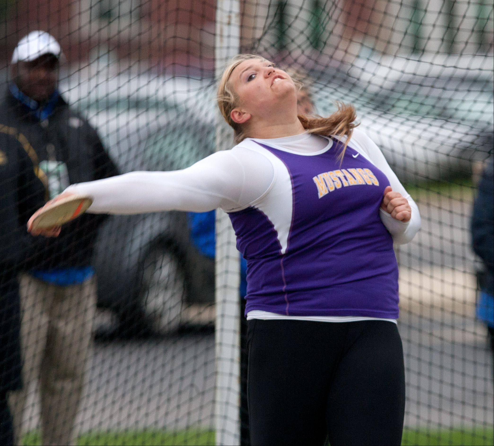 Rolling Meadows' Morgan Keller unleases a winning discus effort this spring in the York sectional meet.