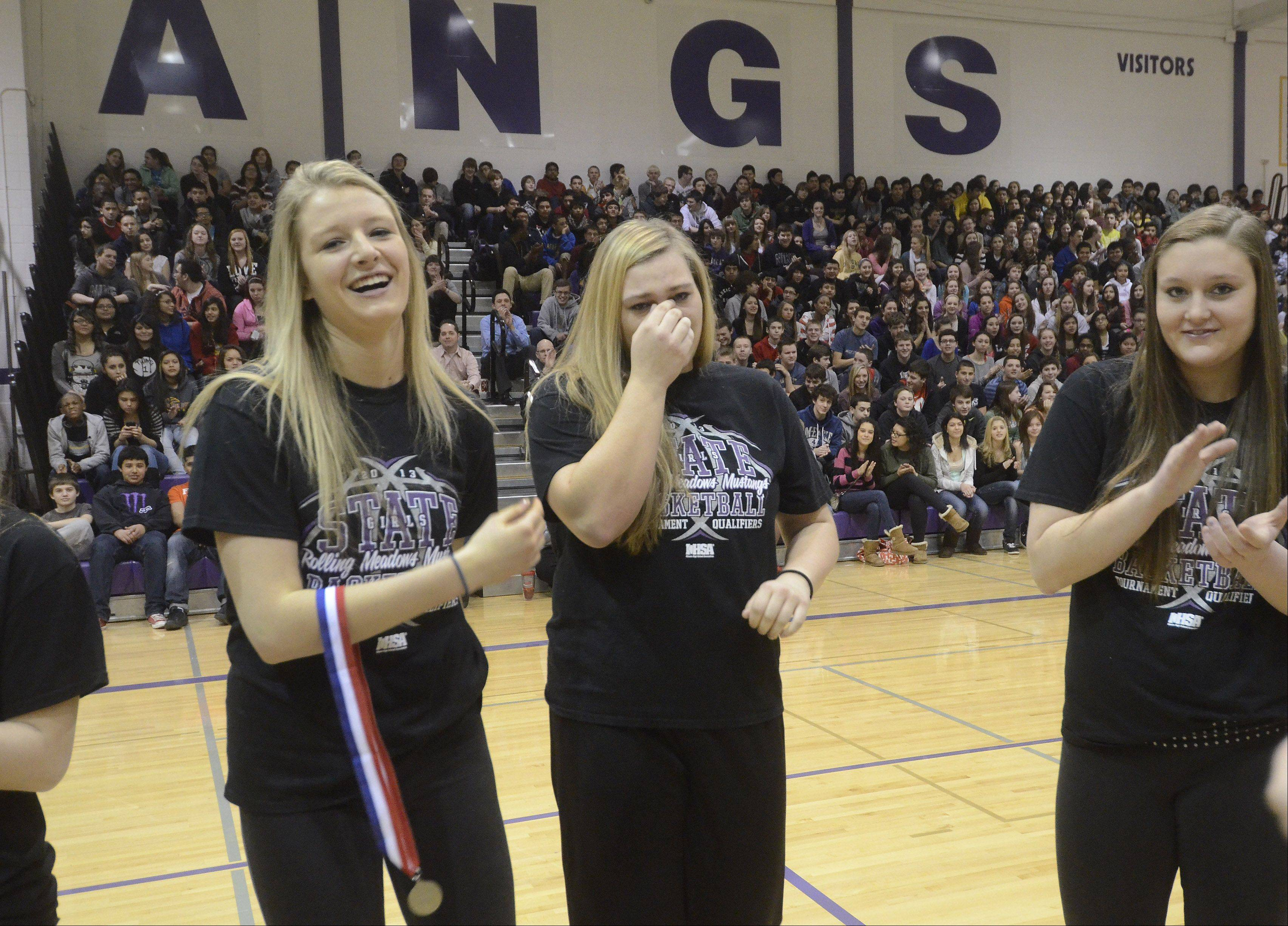 Morgan Keller, middle, gets emotional during the school celebration for Rolling Meadows' state runner-up girls basketball team.