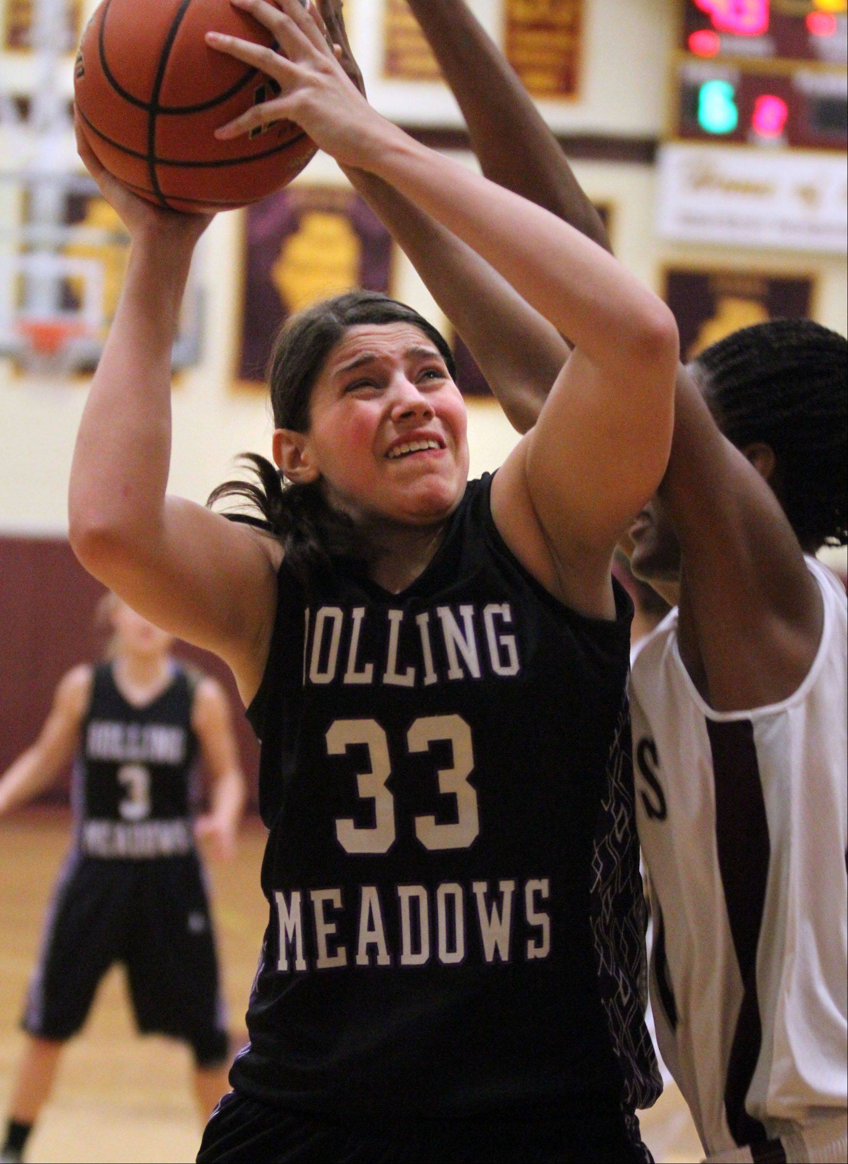 Rolling Meadows' Ashley Montanez shoots against Montini in tournament play last season in Lombard.