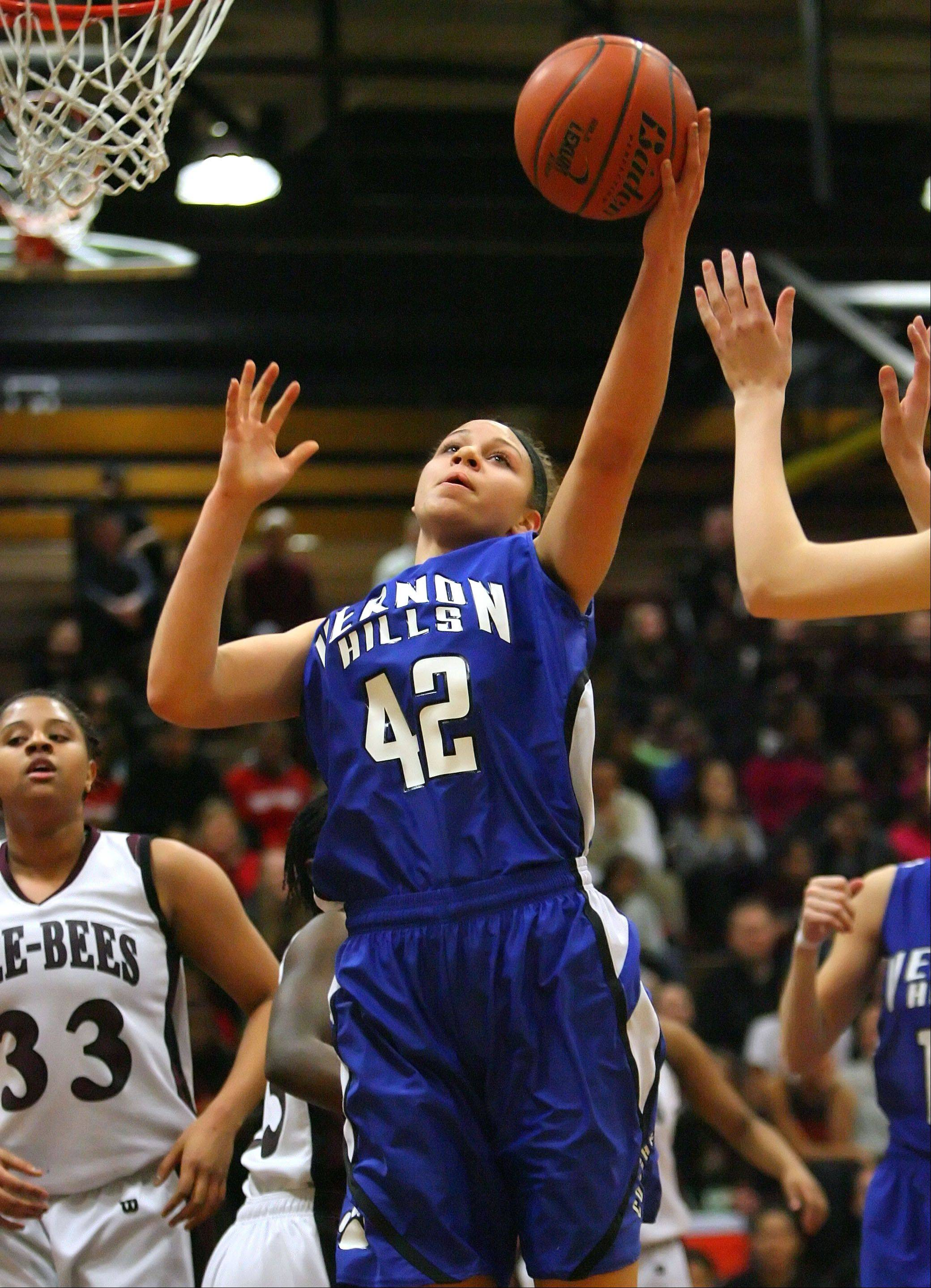 Vernon Hills' Lauren Webb pulls down a rebound during the NSC title game last season at Zion-Benton.