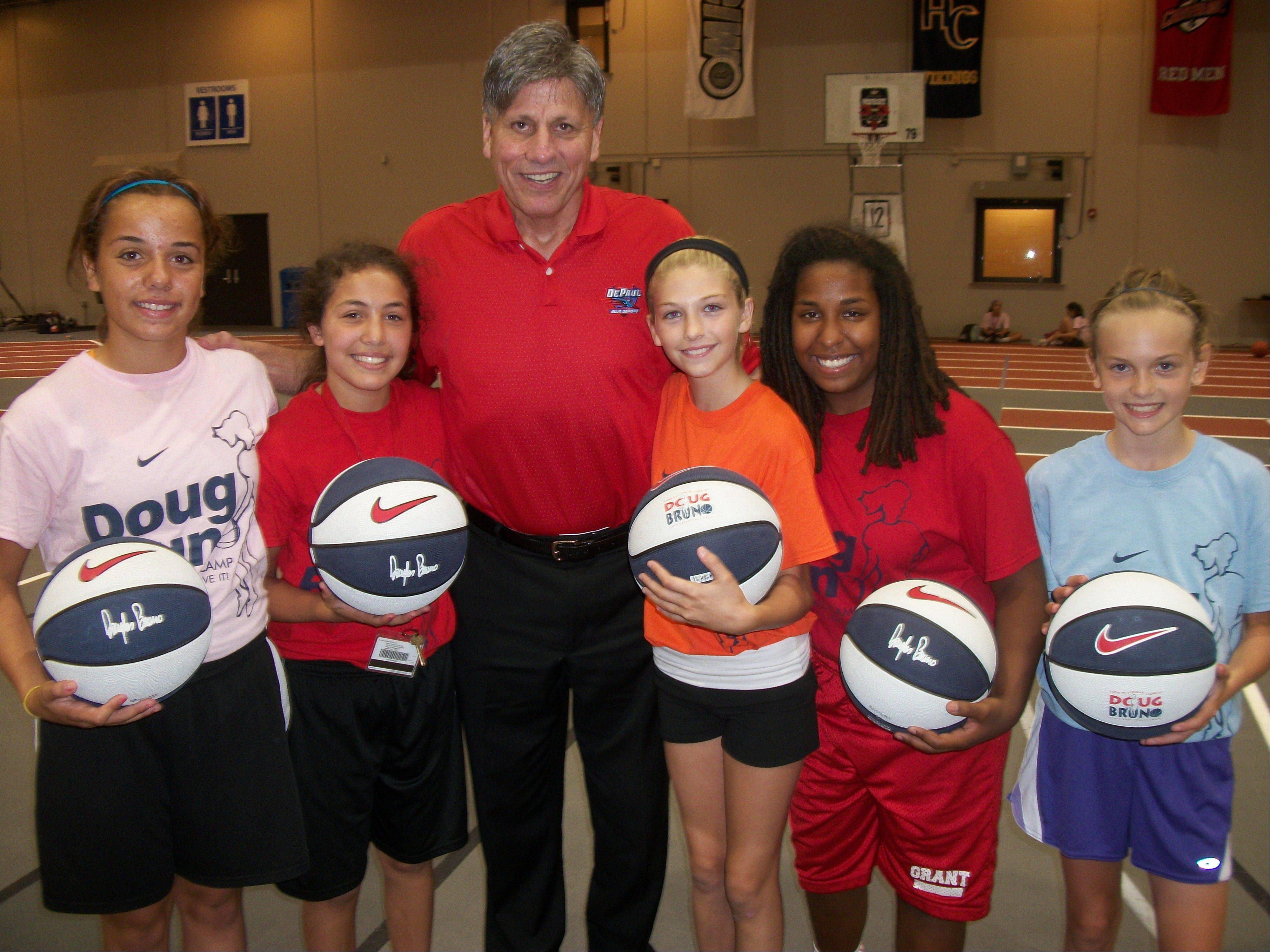 Doug Bruno has been running his girls basketball camps for 37 years. Campers this summer included, from left, Gabby Rogalovich, Mercedes Uribe, Brooke Karpinske, Liz Schram and Kelsey McGraw.