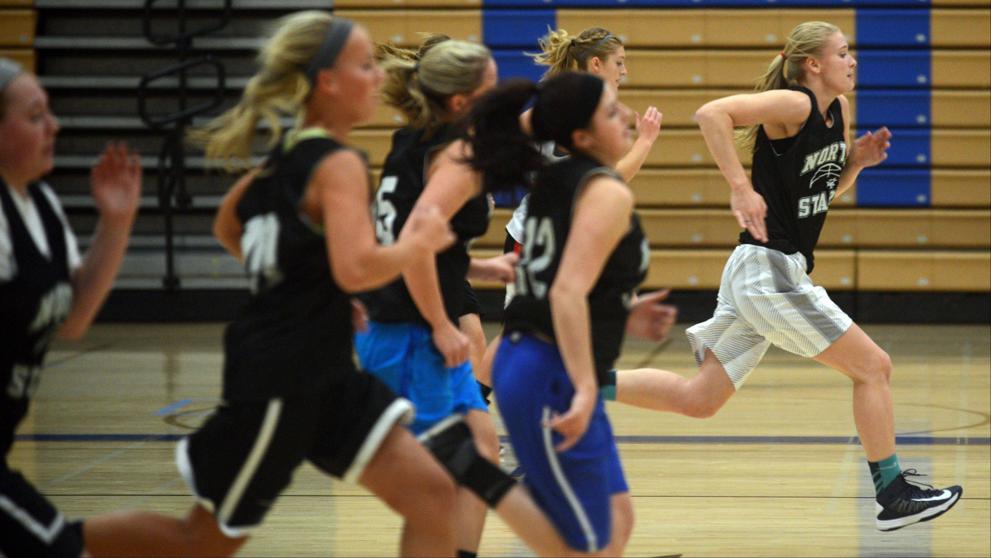 Patrick Kunzer/pkunzert@dailyherald.comThe St. Charles North North Stars girls basketball team practiced on Monday afternoon. New head coach Sean Masoncup led the first day of practice for the season. Here, the team makes full-court sprints.