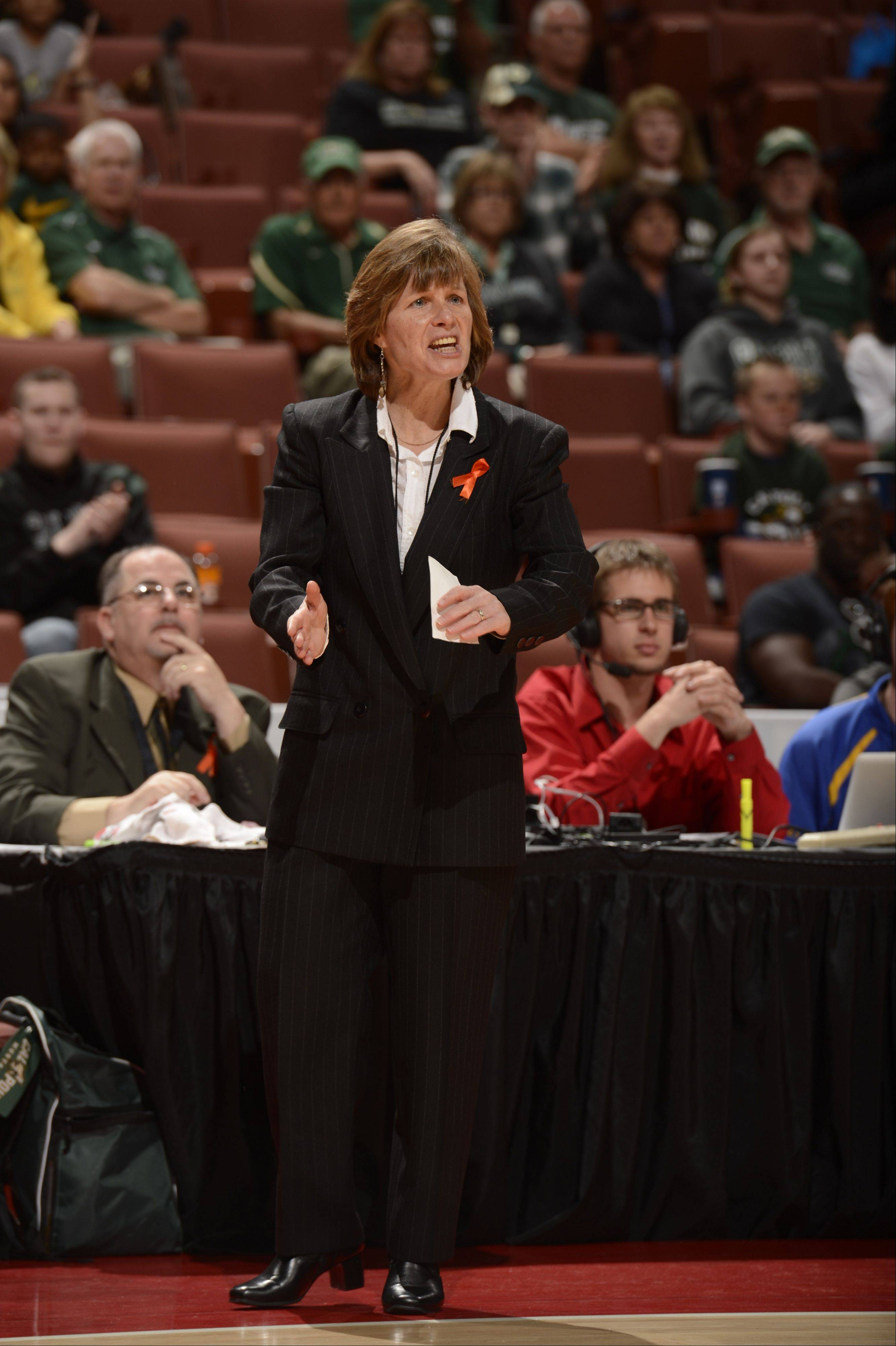 Faith Mimnaugh, who won a state basketball title as a player at Elk Grove High School in 1981, is now in her 17th season as the head coach of women's basketball at Cal Poly. The Mustangs are playing this weekend at DePaul.