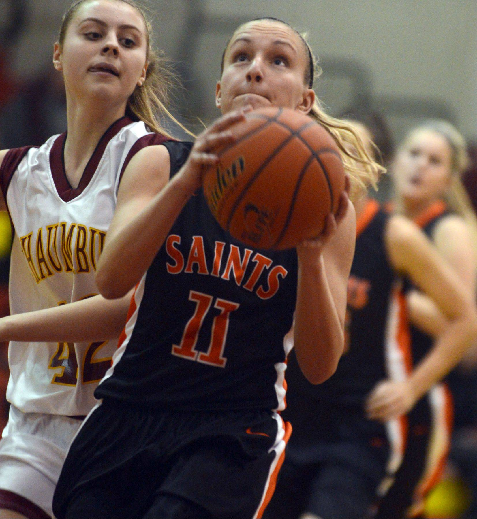 St. Charles East's Katelyn Claussner, right, drives past Schaumburg's Mallory Gerber, left, at Schaumburg Monday.