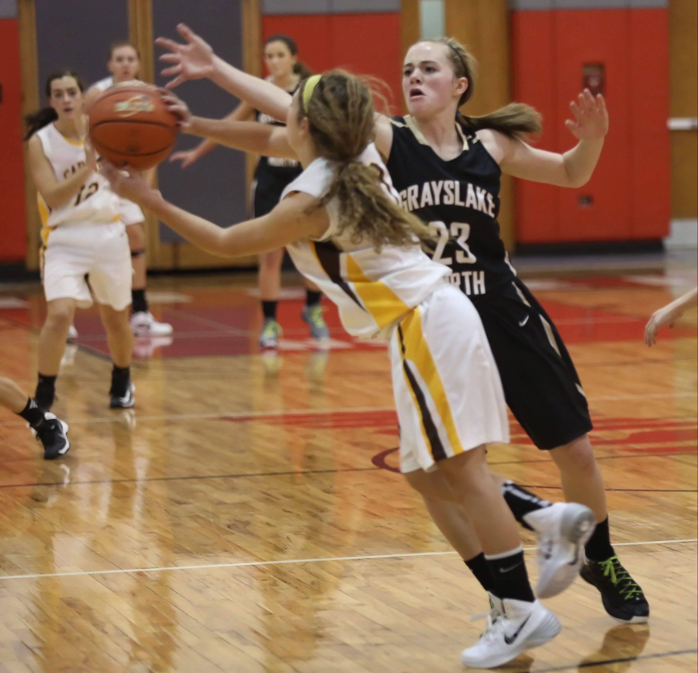 Grayslake North guard Sydney Lovitsch tries to block the pass by Carmel guard Sam Melillo during Monday's in the Mundelein tournament.