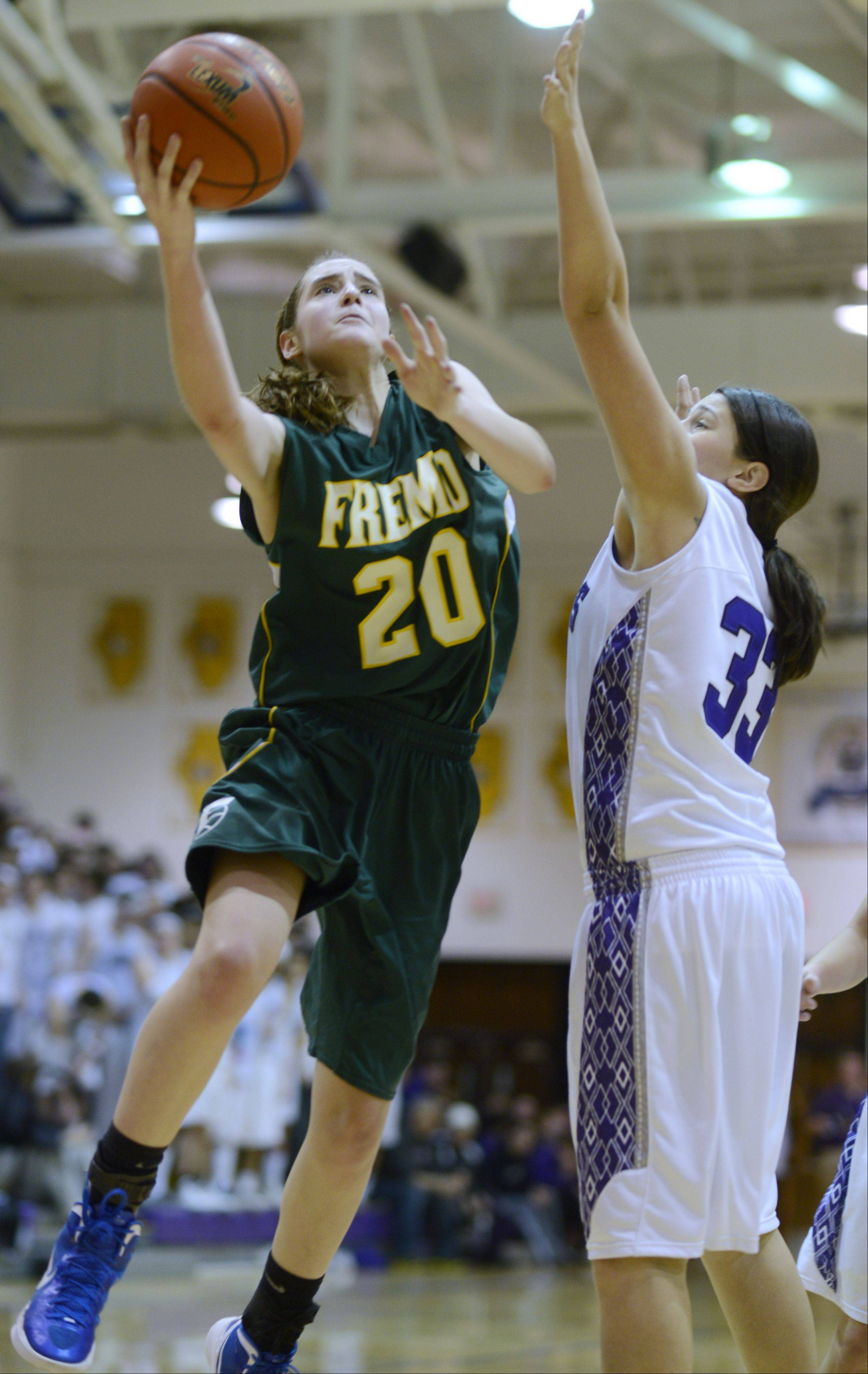 Fremd's Haley Gorecki drives for a layup with Ashley Montanez of Rolling Meadows defending during last season's Mid-Suburban League championship game.