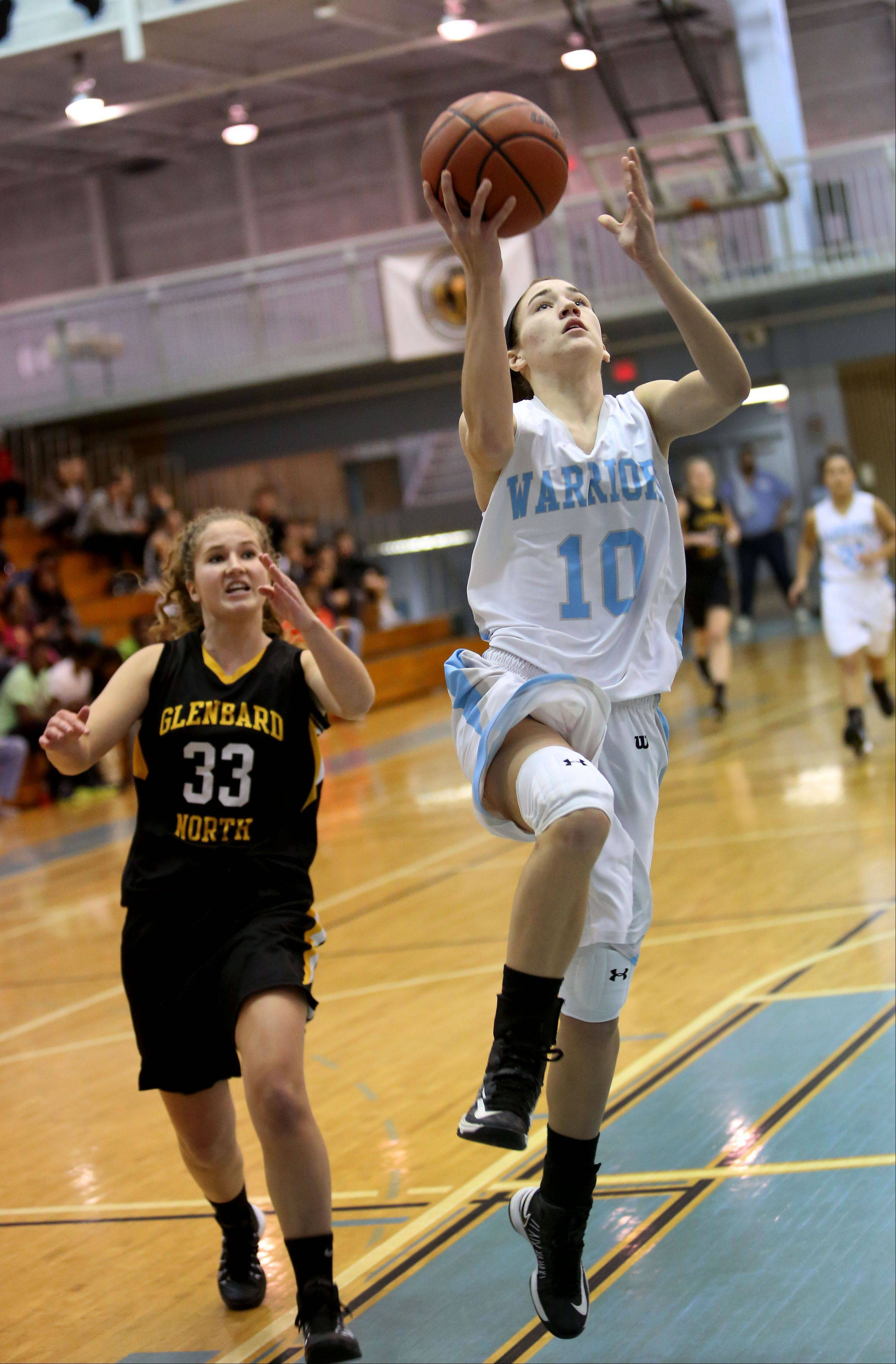 Willowbrook's Molly Krawczykowski goes past Arainna Cannard of Glenbard North for two points during girls basketball on Tuesday in Villa Park.