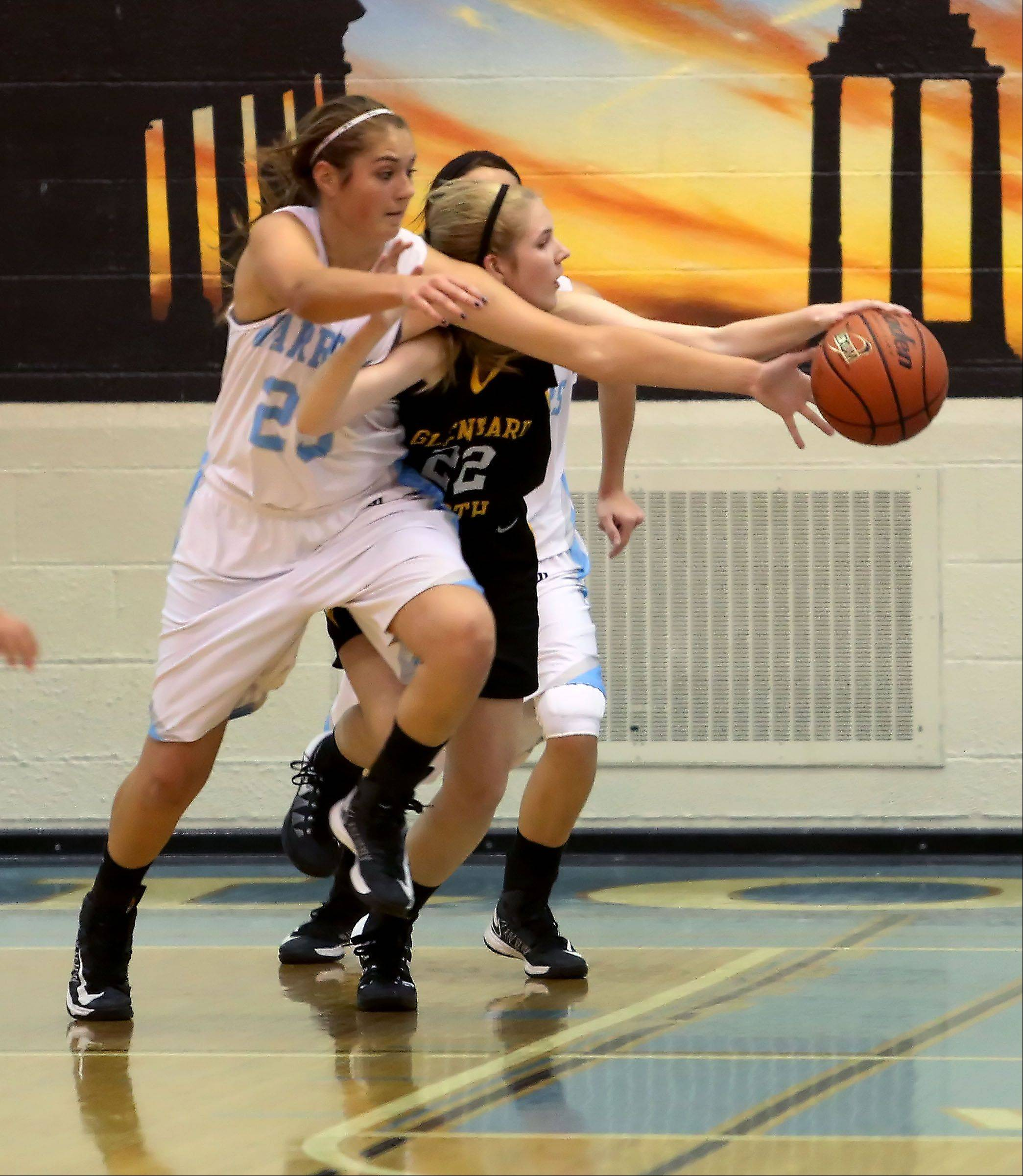 Samantha Schmidt, left, of Willowbrook and Jennifer Deegan, right of Glenbard North, go after a loose ball during girls basketball on Tuesday in Villa Park.