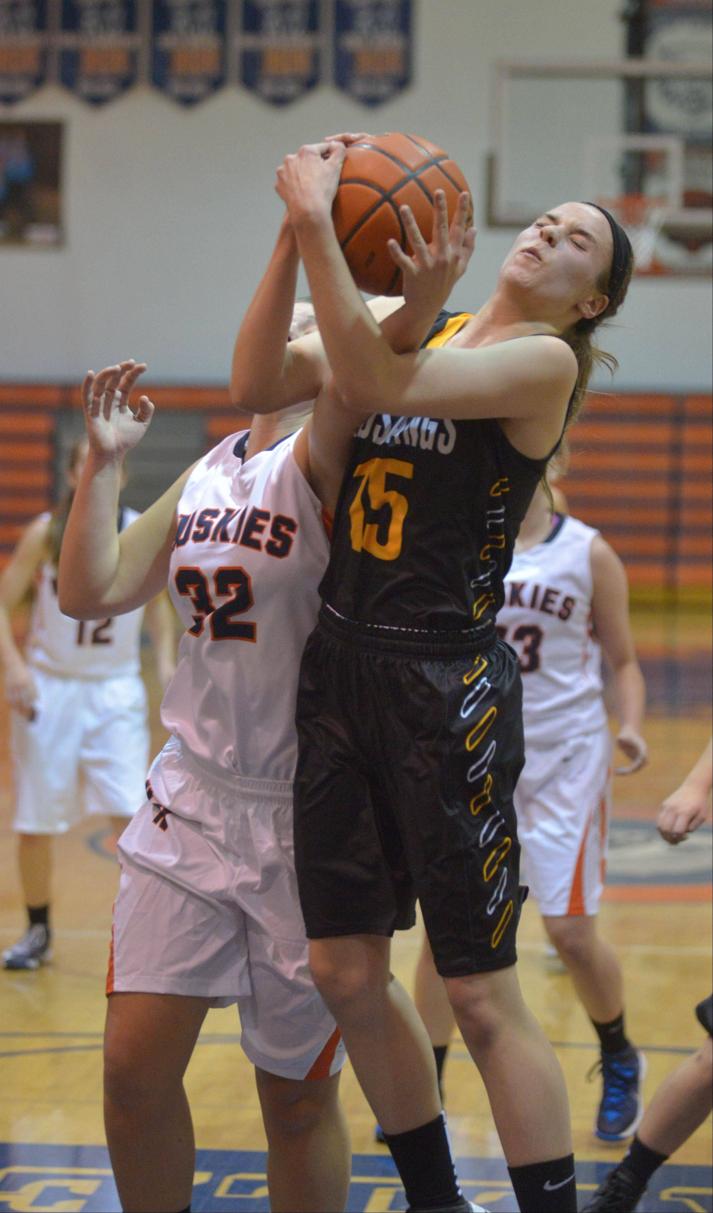 Morganne Freeman of Naperville North and Jenny Voytell of Metea go up for a rebound during the Metea Valley at Naperville North girls basketball game Tuesday.