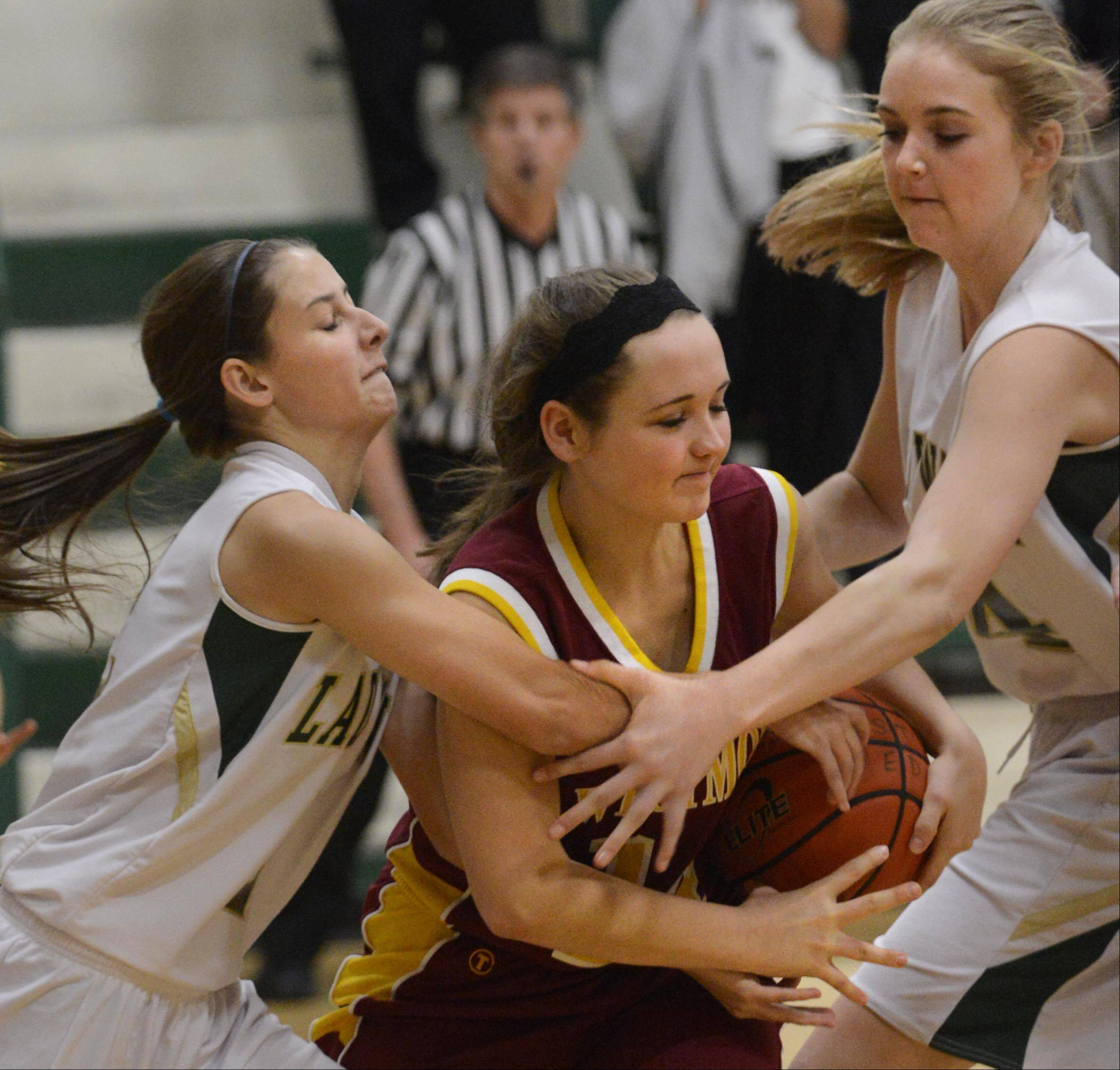 St. Edward's Chelsea Gnan and Cece Rapp, right, double team Westmont's Rachel Kurt Tuesday in Elgin.