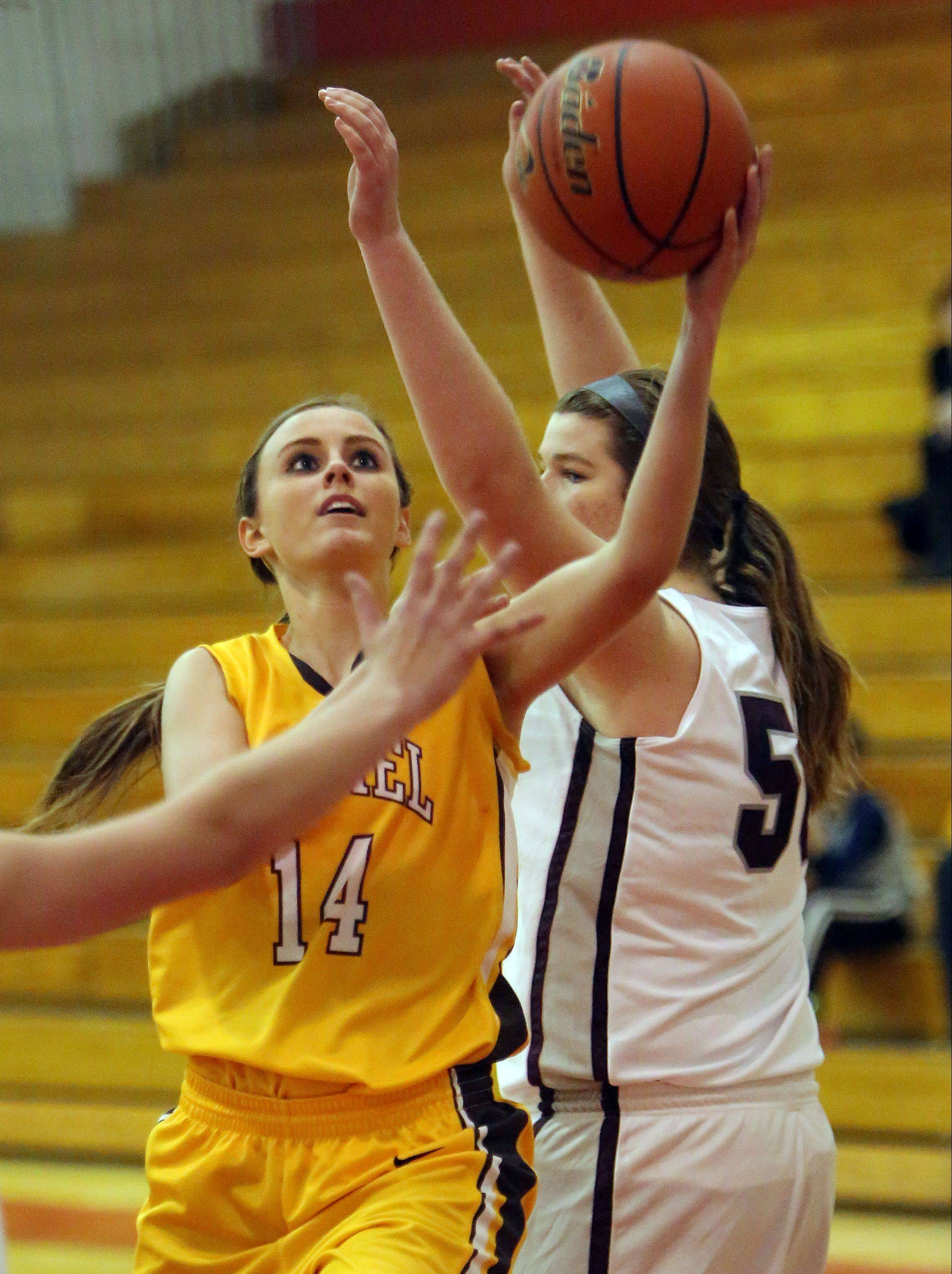 Carmel's Cassidy Kloss, left, drives on Prairie Ridge's Maddie Drain on Wednesday at Mundelein.