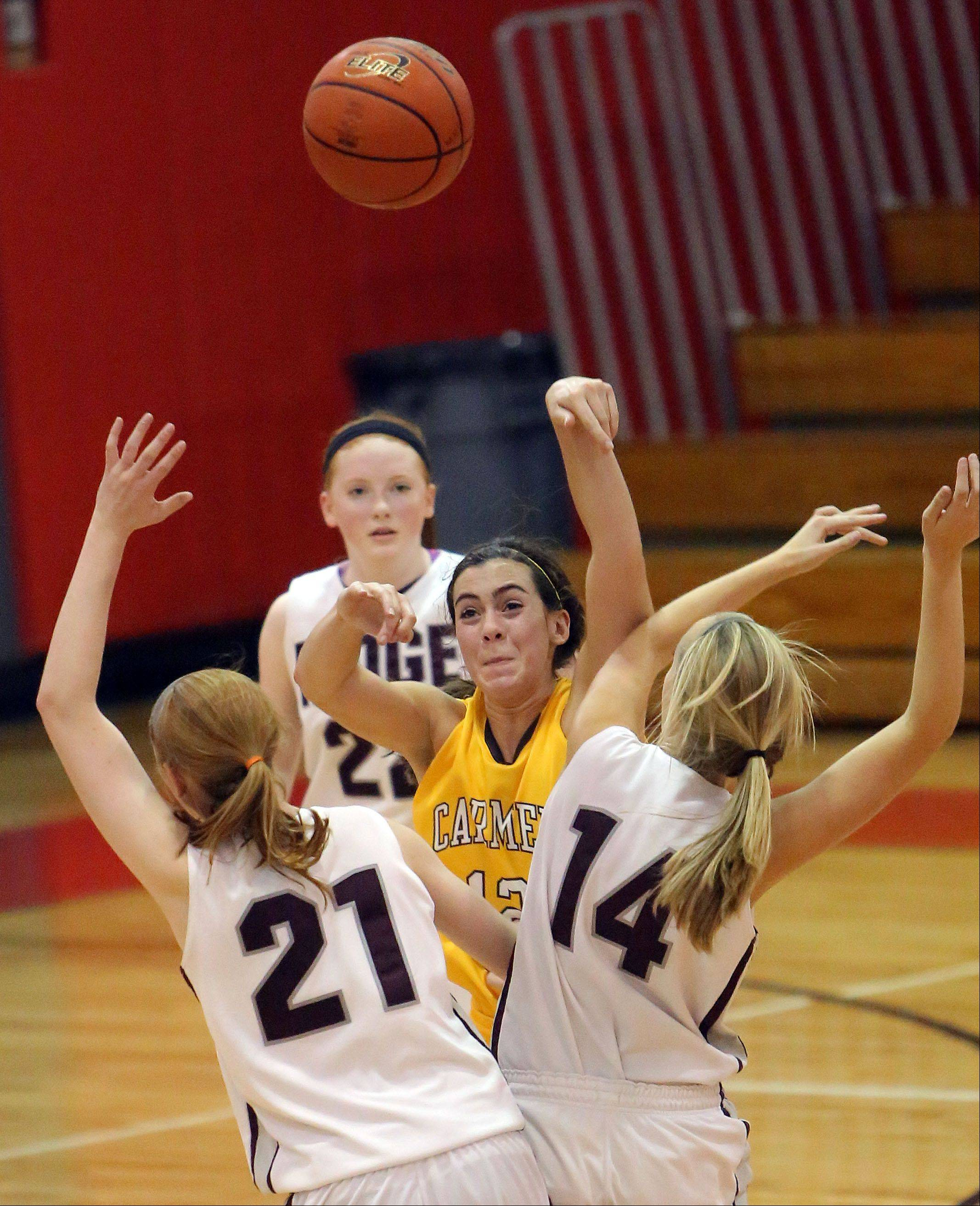 Carmel's Kathleen Felicelli, middle, passes over Prairie Ridge's Kelly Klendworth, left, and Sarah Kilhoffer on Wednesday at Mundelein.
