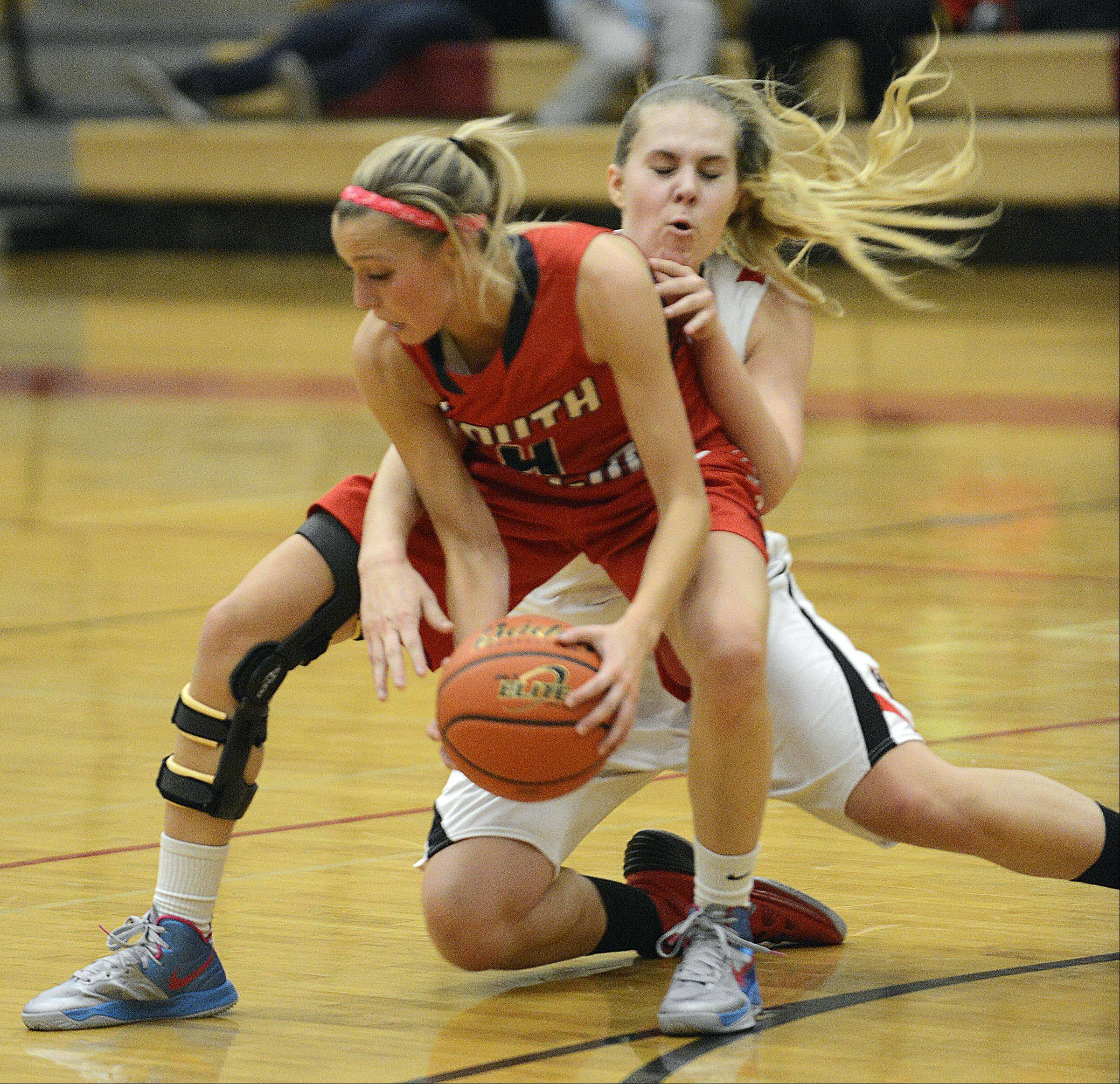 South Elgin's Savanah Uveges backs into Huntley's Ali Andrews Wednesday in Huntley.