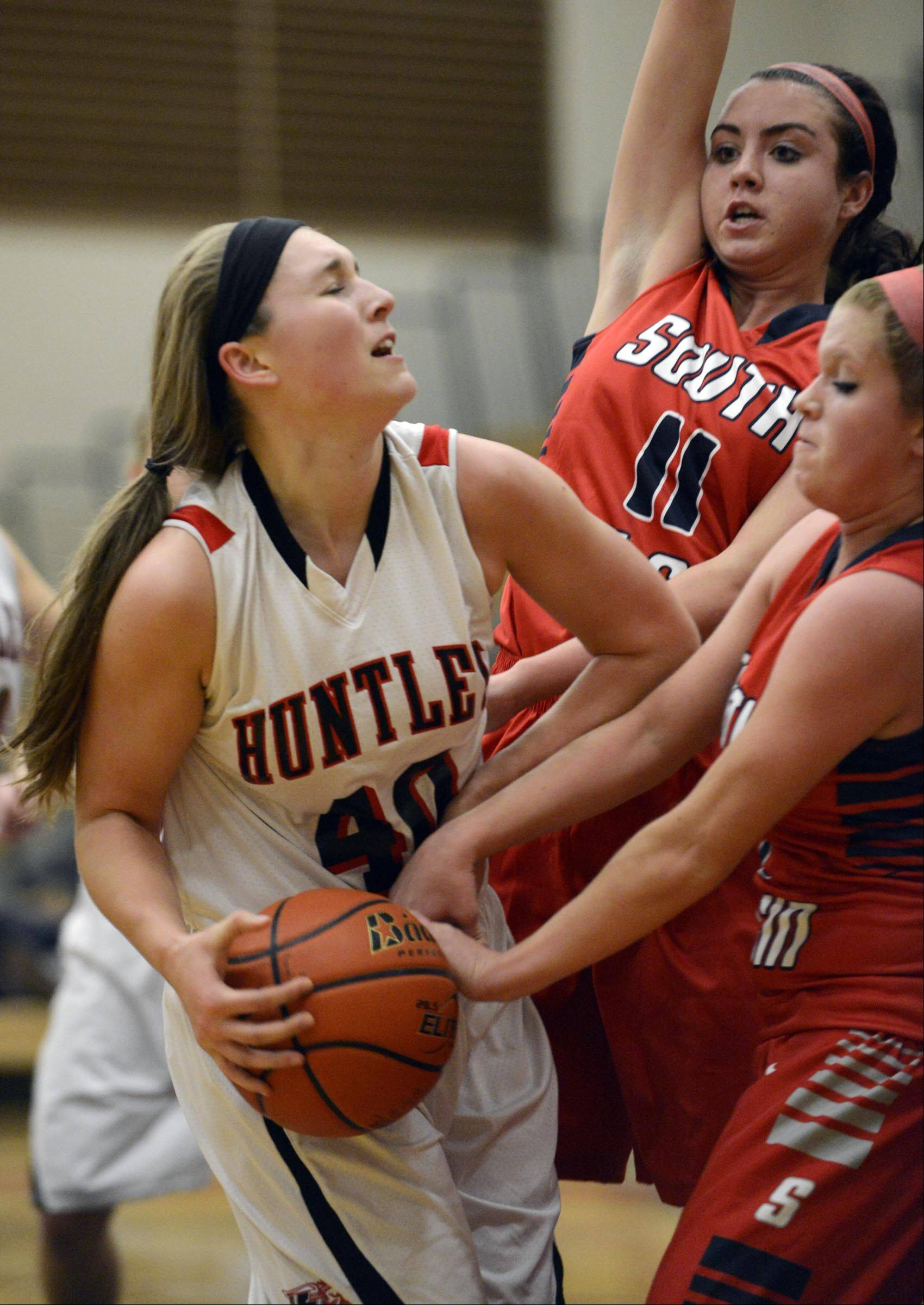 South Elgin's Anna Tracy has the ball stripped by Huntley's Sam Andrews Wednesday in Huntley as South Elgin's Delaney Kelleher defends.