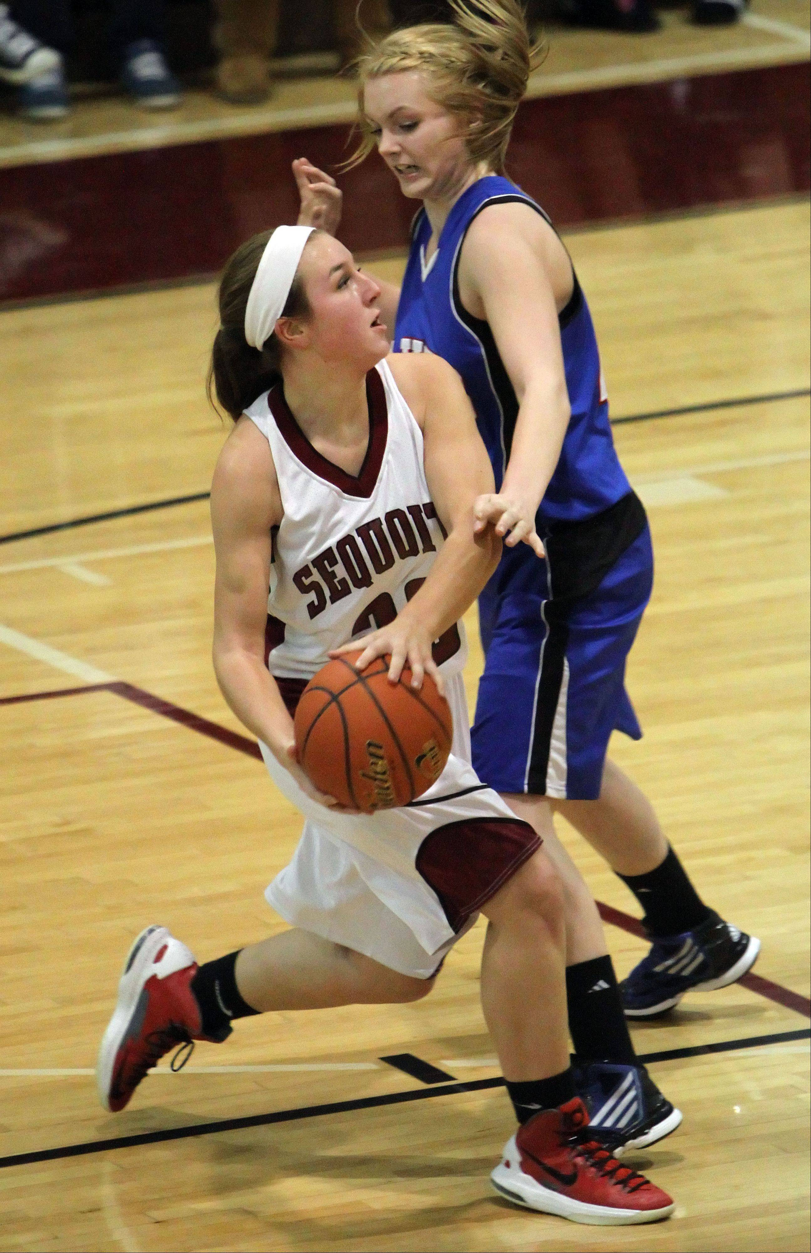 Steve Lundy/slundy@dailyherald.com ¬ Antioch's Paige Gallimore, left drives on Lakes' Amanda Beetschen last seasaon. Gallimore returns for her third varsity season.