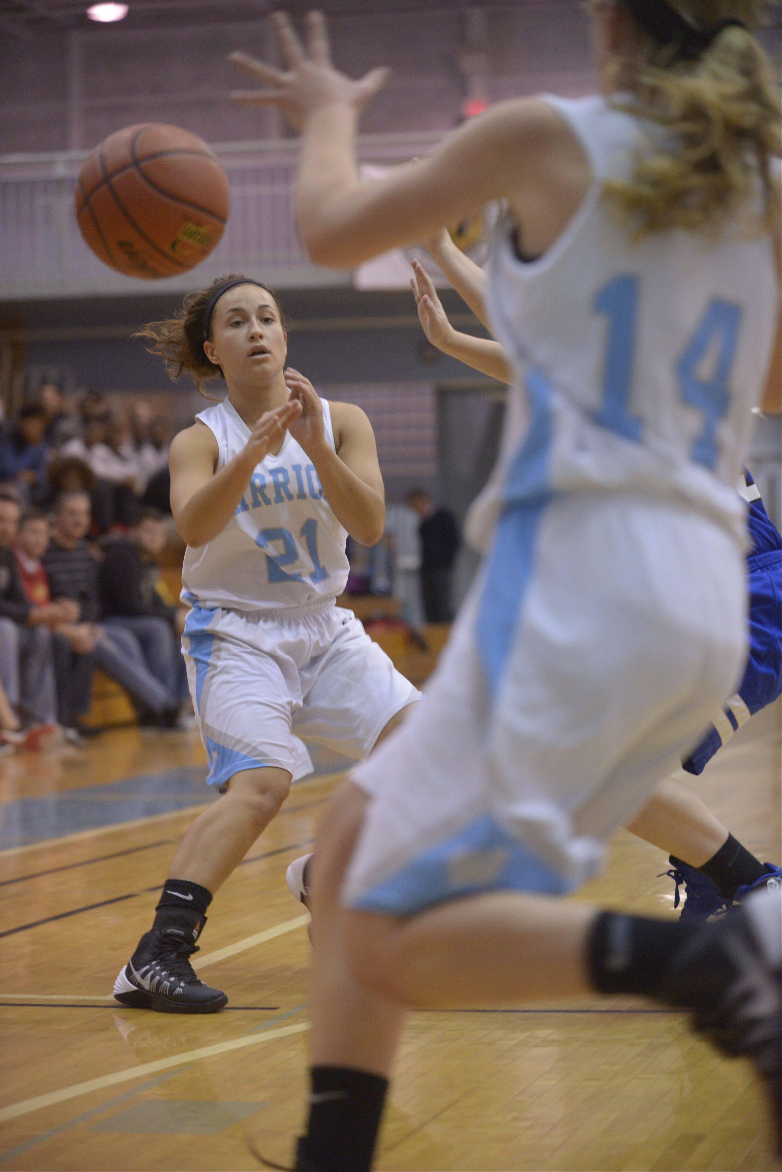 Willowbrook's Olivia Domin passes the ball to teammate Lauren Carroll during girls basketball against St. Francis in Villa Park, Thursday.