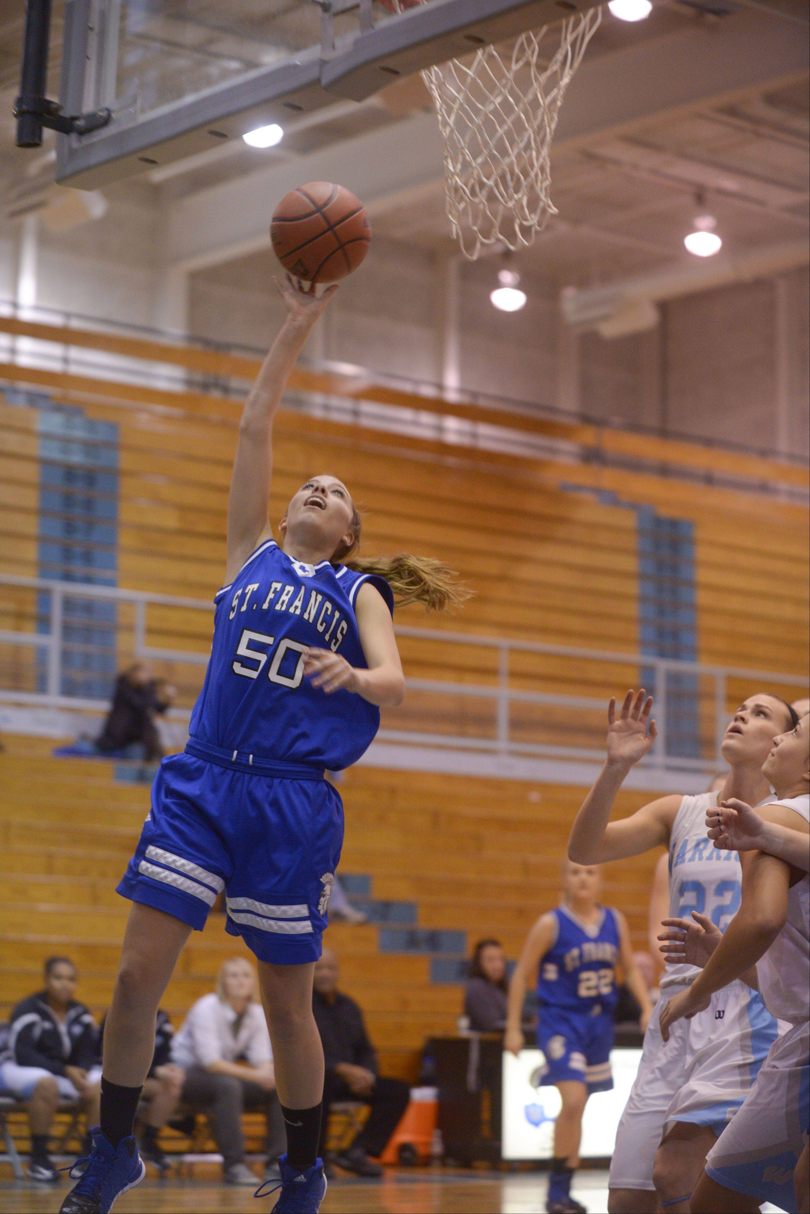 St. Francis' Reagan Sproat drives to the basket against Willowbrook, during girls basketball in Villa Park, Thursday.