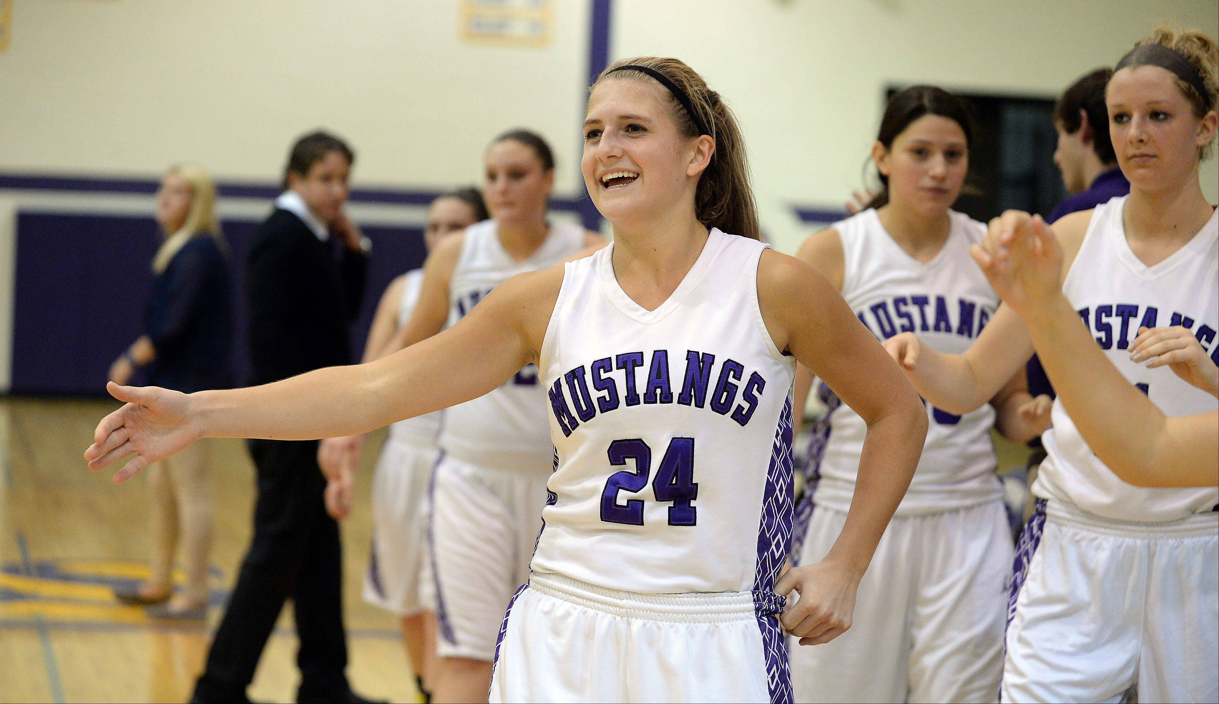 Rolling Meadows' Alexis Glasgow is all smiles after Thursday's season opener against Cary-Grove, during which the Northwestern recruit eclipsed the 1,000-point mark in a 75-59 Mustangs triumph.