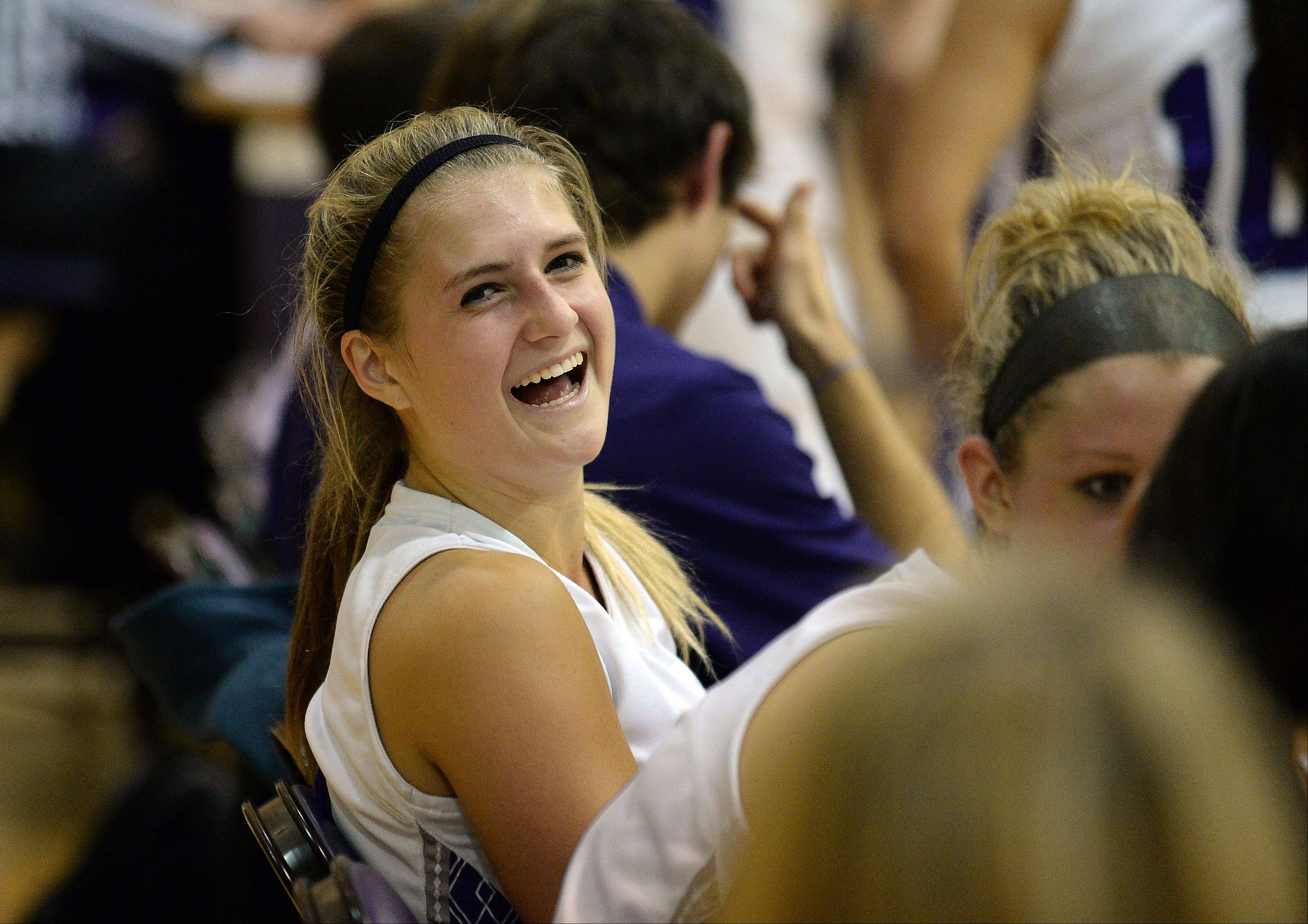 Rolling Meadows' Alexis Glasgow enjoys Thursday's season opener against Cary-Grove, during which the Northwestern recruit eclipsed the 1,000-point mark in a 75-59 Mustangs triumph.