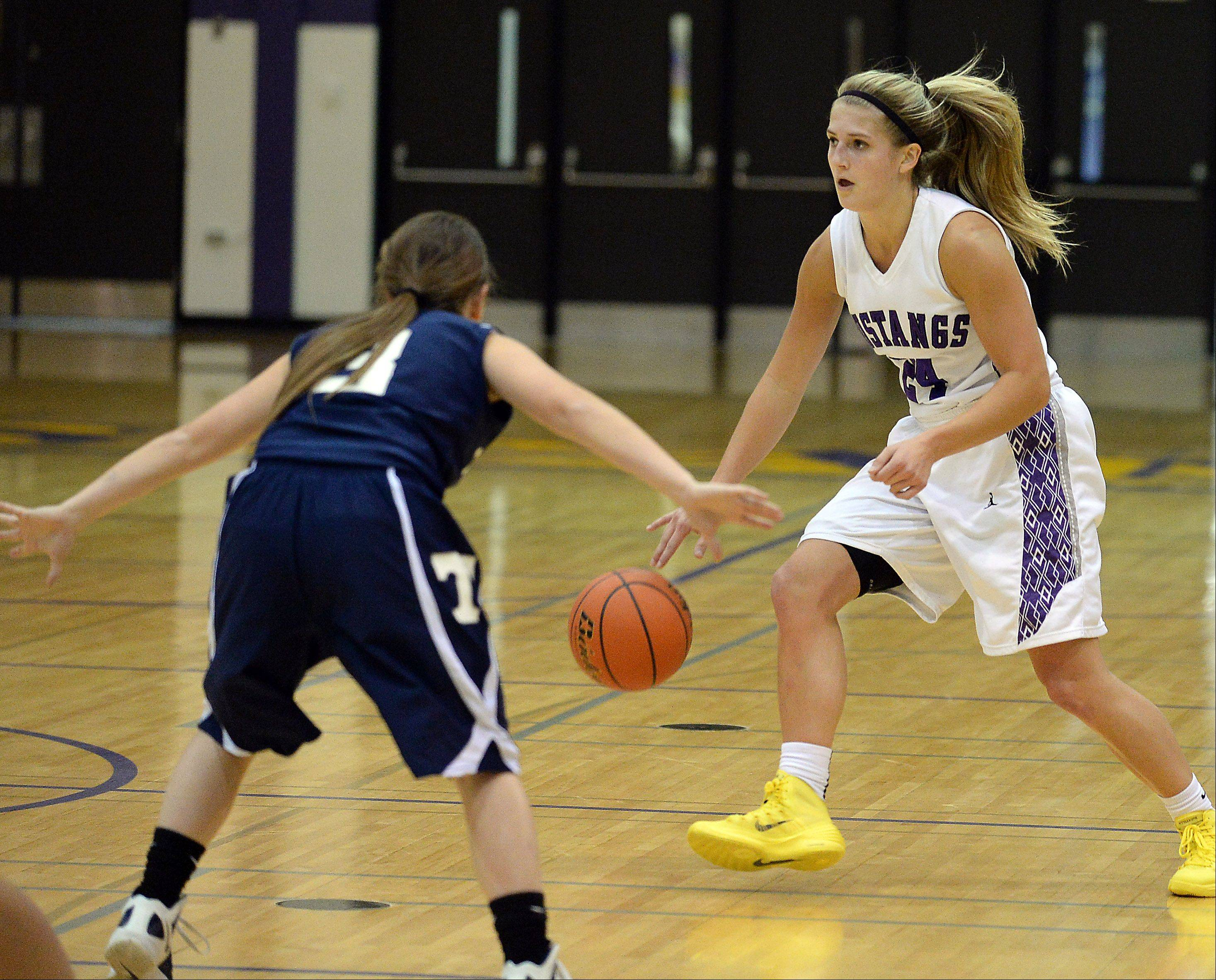 Rolling Meadows' Alexis Glasgow goes up against Cary-Grove's Amy Clemment on Thursday at Rolling Meadows.