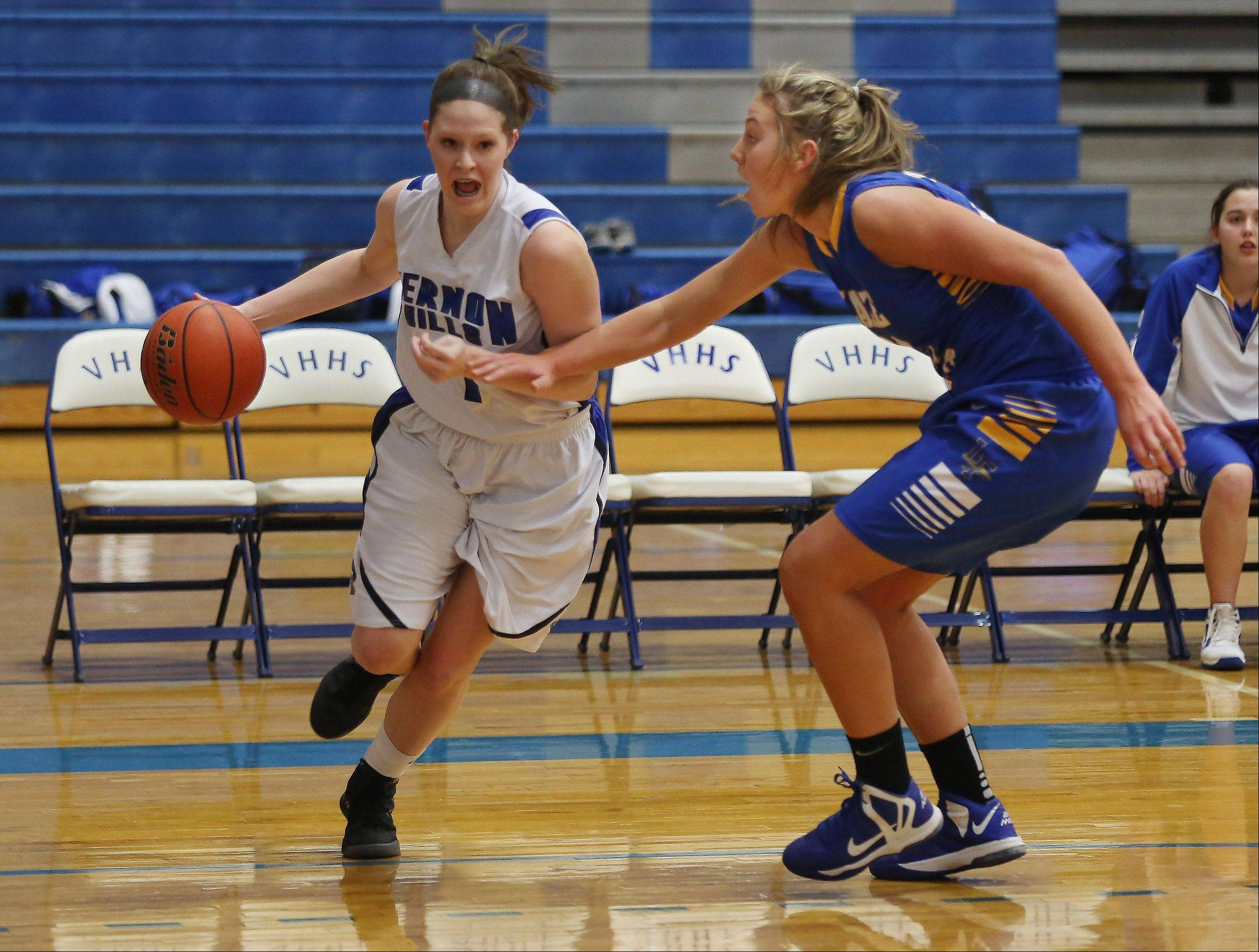 Vernon Hills forward Sydney Smith drives around Lake Forest forward Grace Torkelson on the way to the basket Thursday at Vernon Hills.