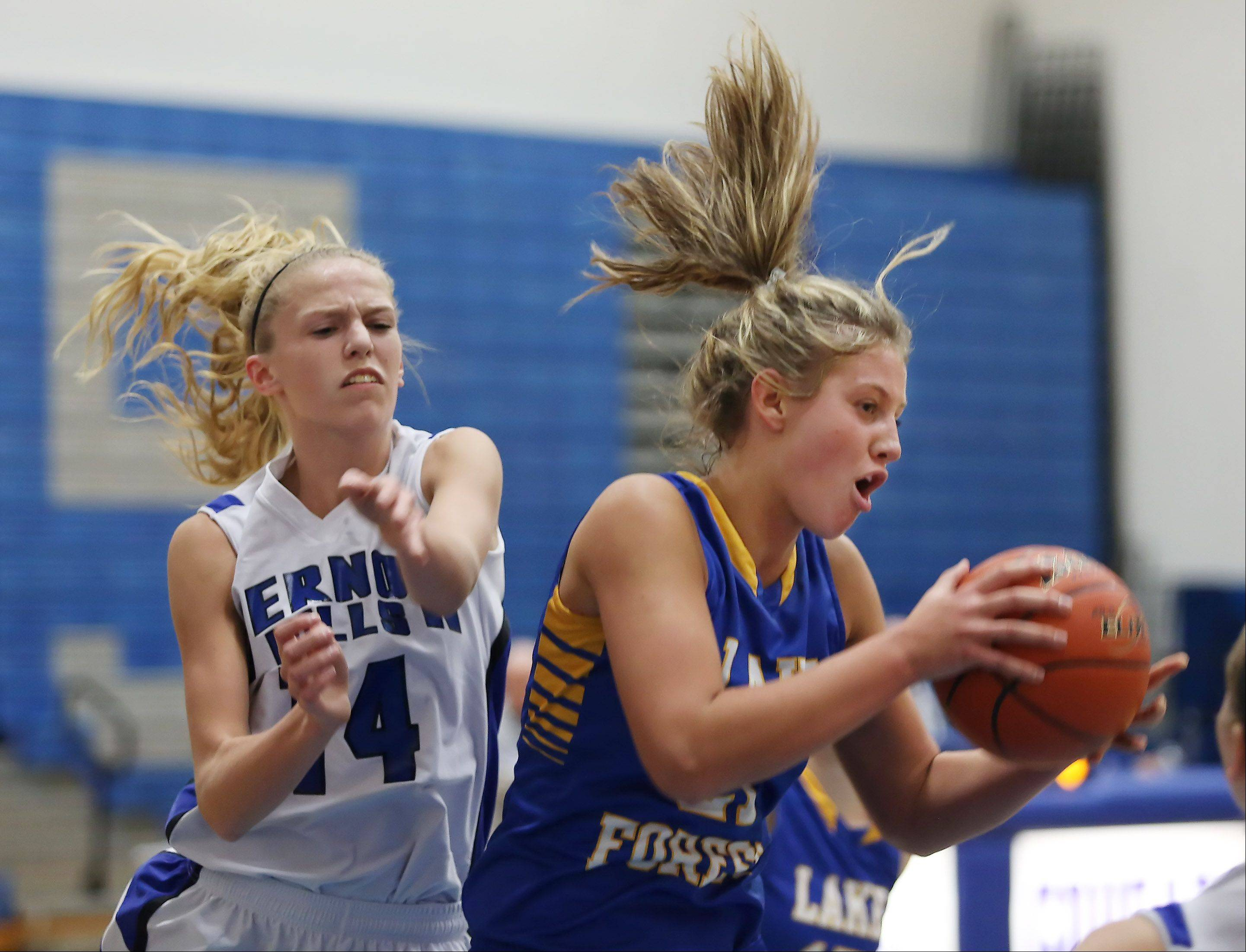 Lake Forest forward Grace Torkelson grabs the rebound away from Vernon Hills forward Kasey Firnbach on Thursday at Vernon Hills.