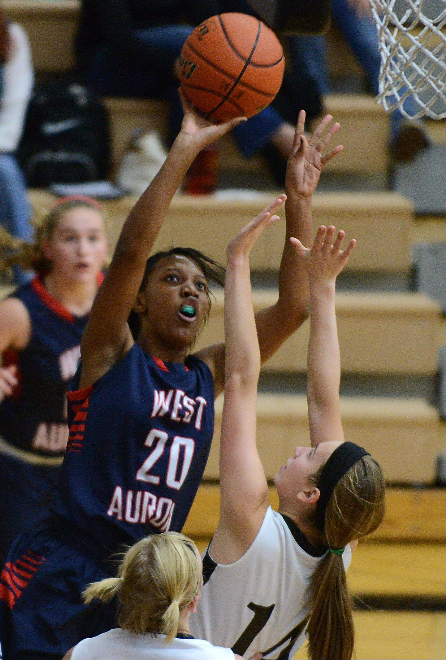 West Aurora's Joslyn Noel (20) shoots over Kaneland's Vanessa Gould (14) during Thursday's game in Maple Park.