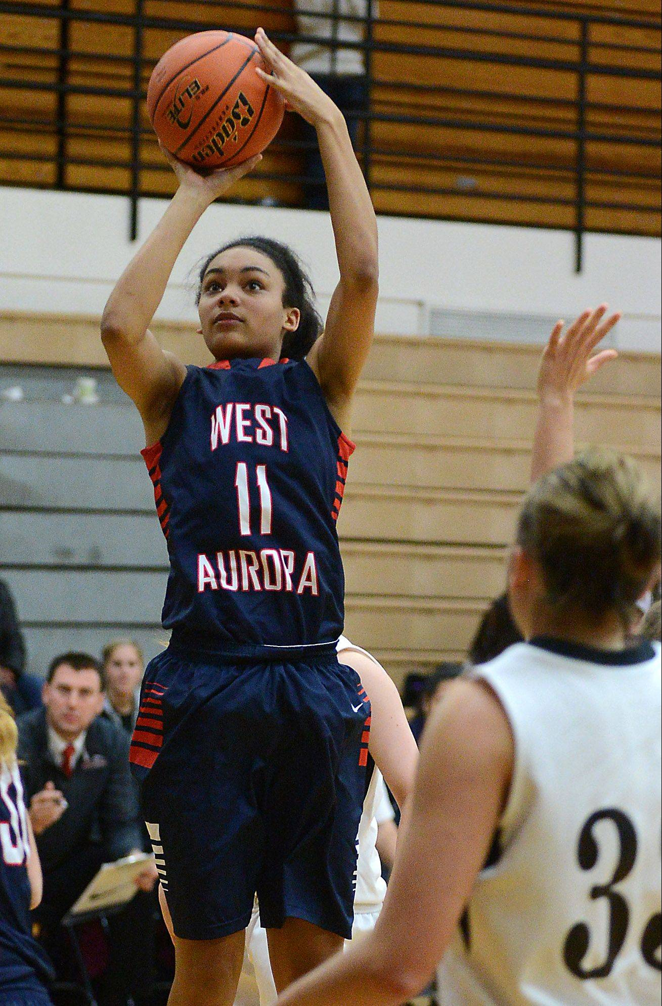 West Aurora's Abriya Zeitz (11) shoots and scores against Kaneland during Thursday's game in Maple Park.