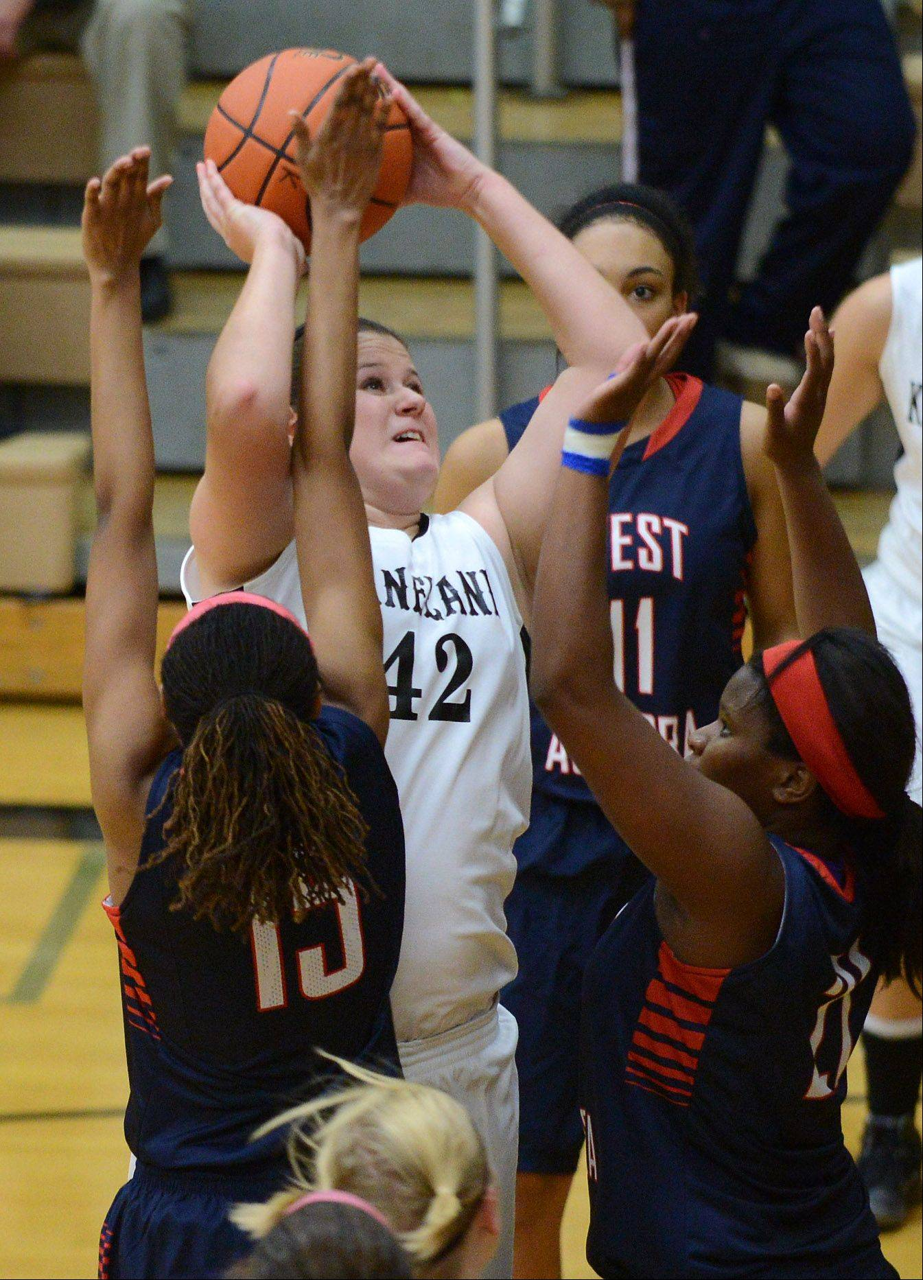 Kaneland's Kelly Wallner (42) puts up a shot while surrounded by West Aurora defenders during Thursday's game in Maple Park.