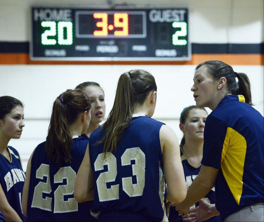Kirkland Hiawatha head girls basketball coach Jenna Araujo speaks with her team early in the game Thursday against Hampshire in the Elgin Academy Thanksgiving Tournament. Araujo, nee Real, is a former Burlington Central standout and coach.