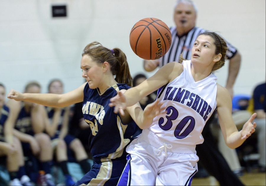 Hampshire's Tricia Dumoulin is fouled by Kirkland Hiawatha's Lauren Watson Thursday in the Elgin Academy Thanksgiving Tournament.