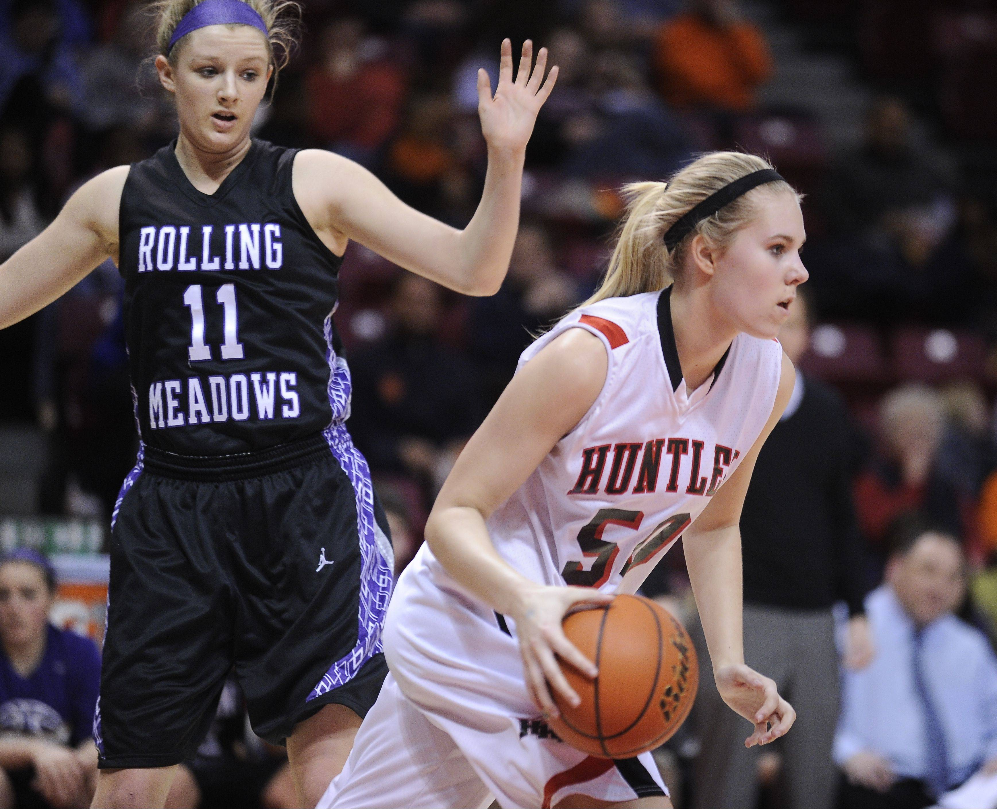 Huntley sophomore Ali Andrews moves with the basketball against Rolling Meadows during the Class 4A state semifinals at Redbird Arena last season.