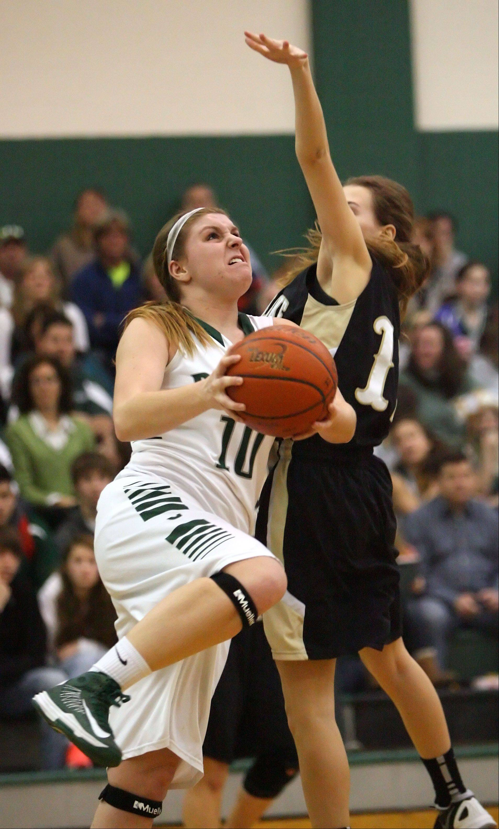Grayslake Central's Maddy Miller, left, drives on Grayslake North's Emily Dugan during action last season. Miller is one of four returning starters for the Rams.