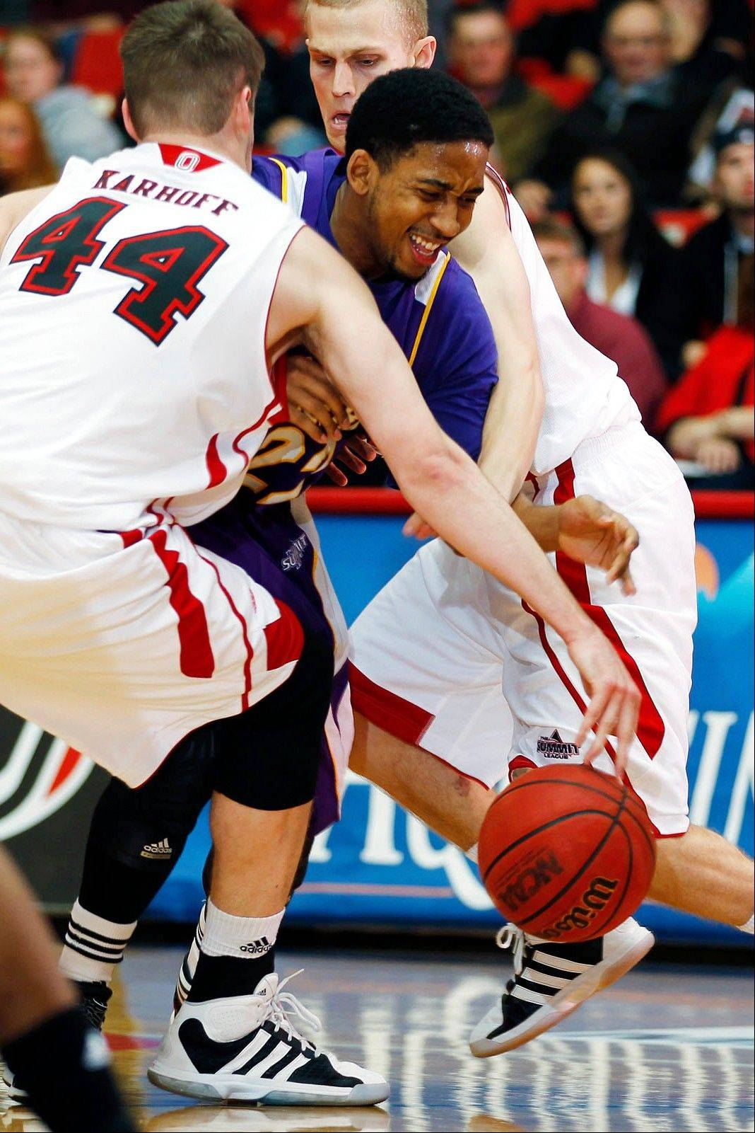 Former Warren standout Ceola Clark splits a double team from Nebraska-Omaha while playing for Western Illinois. With his playing career recently concluded, Clark is back in the North Suburban Conference as an assistant coach at Mundelein.