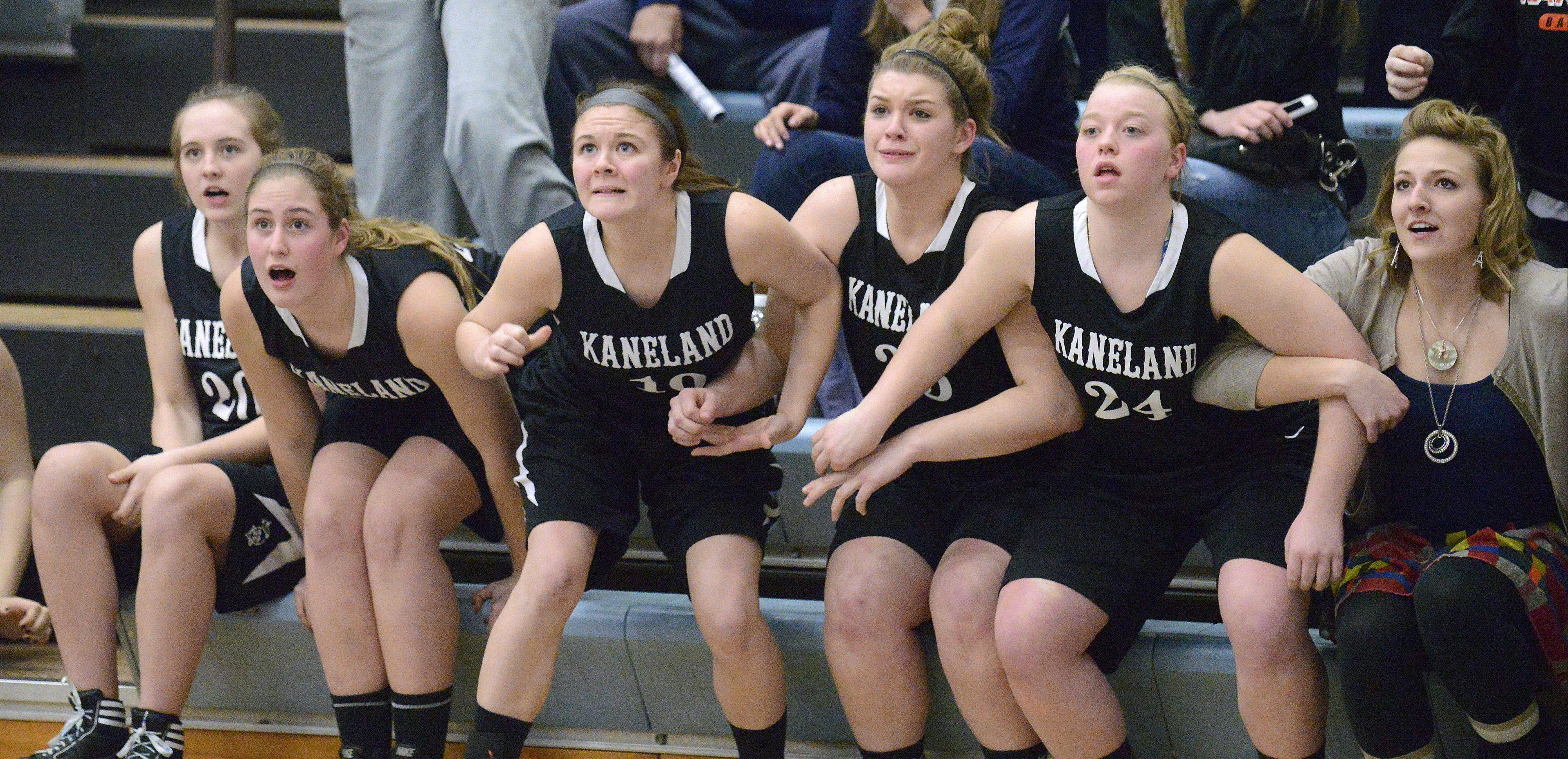 Kaneland's Ally VanBogaert, Katherine Brinkman, Brittany Kemp and Amber Winquist-Bailey cheer the Knights on in regional play last year. This year the four will take on increased roles for Ernie Colombe's squad.
