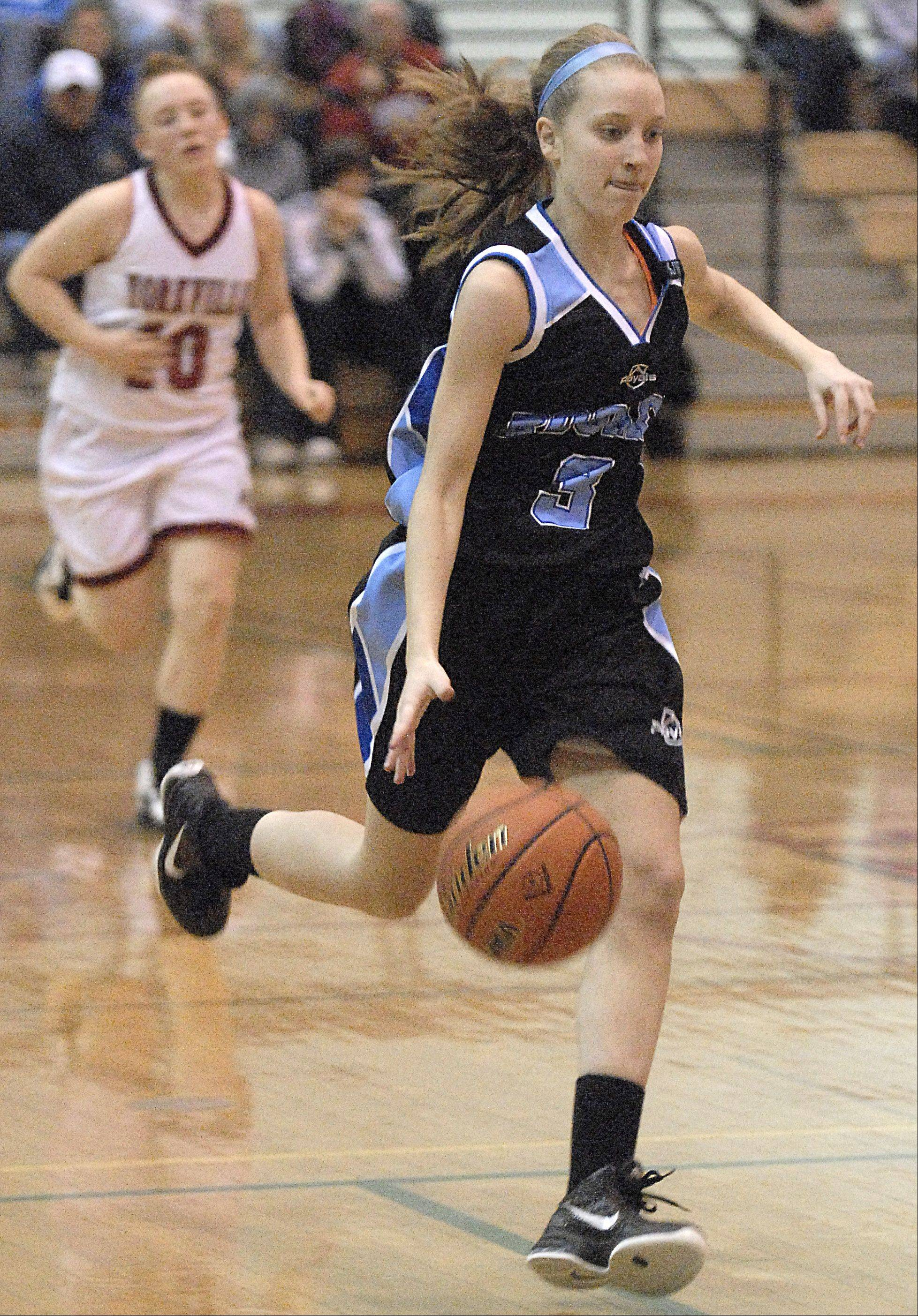 Laura Stoecker/lstoecker@dailyherald.com ¬ Rosary's Rachel Choice sprints down the court in the first quarter vs Yorkville at the regional game on Wednesday, February 15.