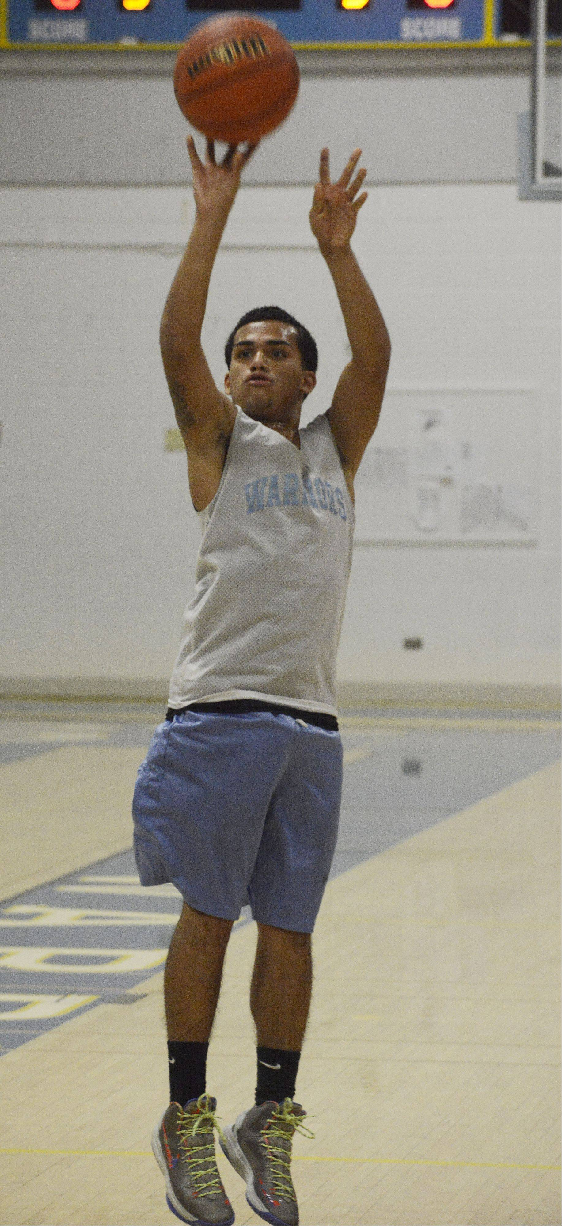 Maine West's Anthony Dones takes a shot during practice.