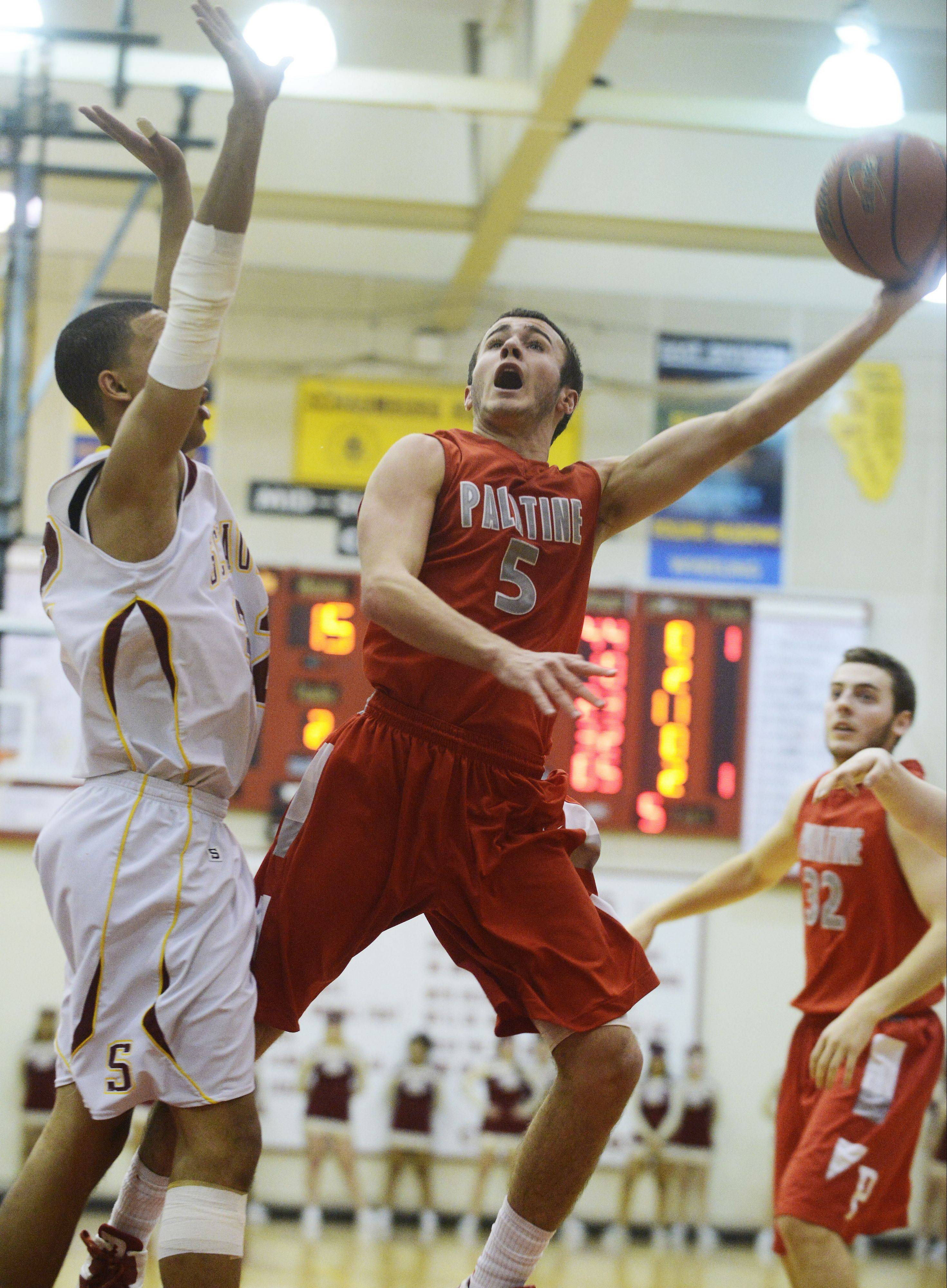 Palatine point guard Chris Macahon gets to the basket for a layup against Schaumburg last season.
