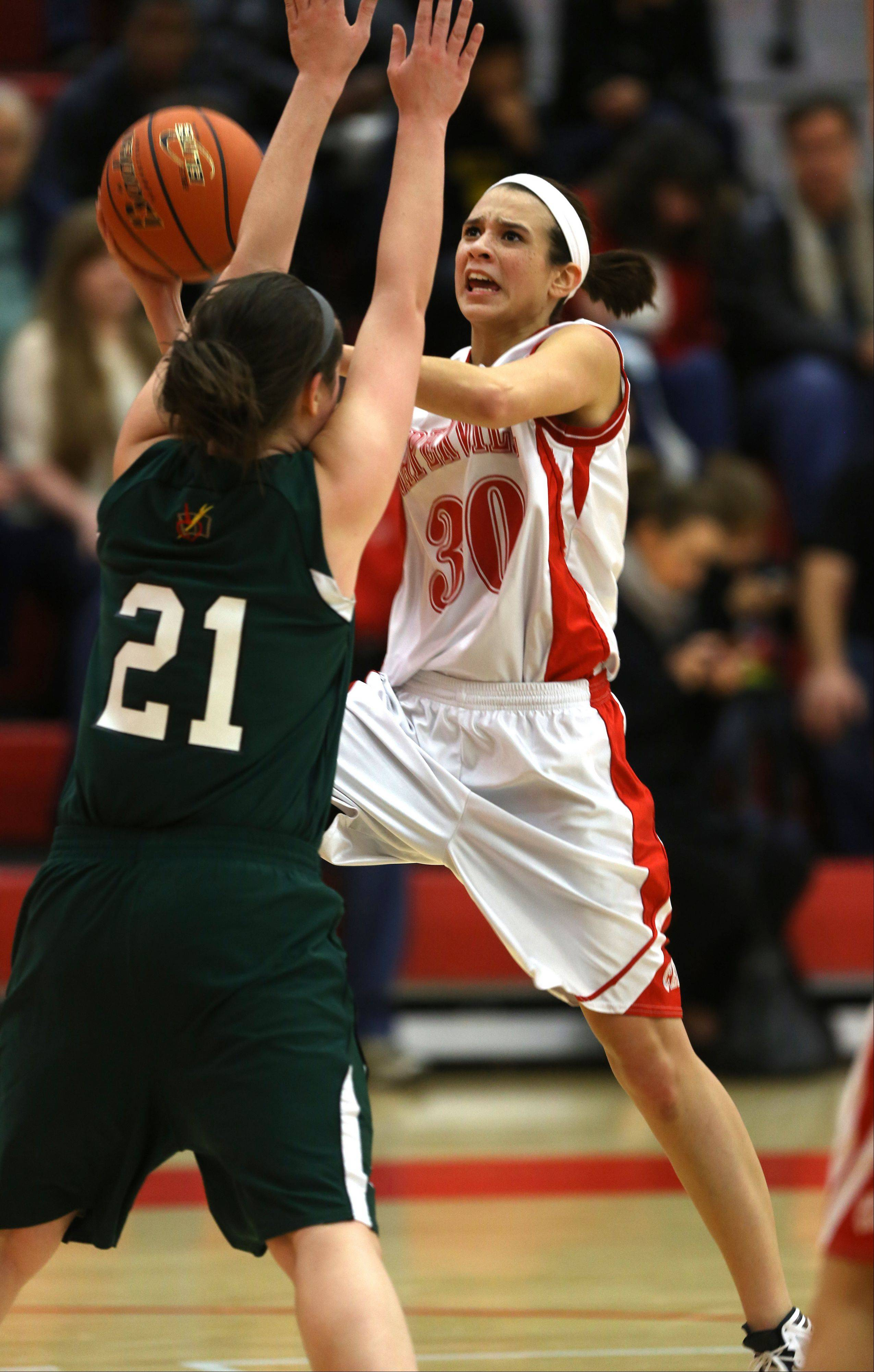 Naperville Central's Shannon Ryan drives the lane against Providence's Mary Fashingbauer (21), during the 2013 girls basketball Tip-Off Tournament.