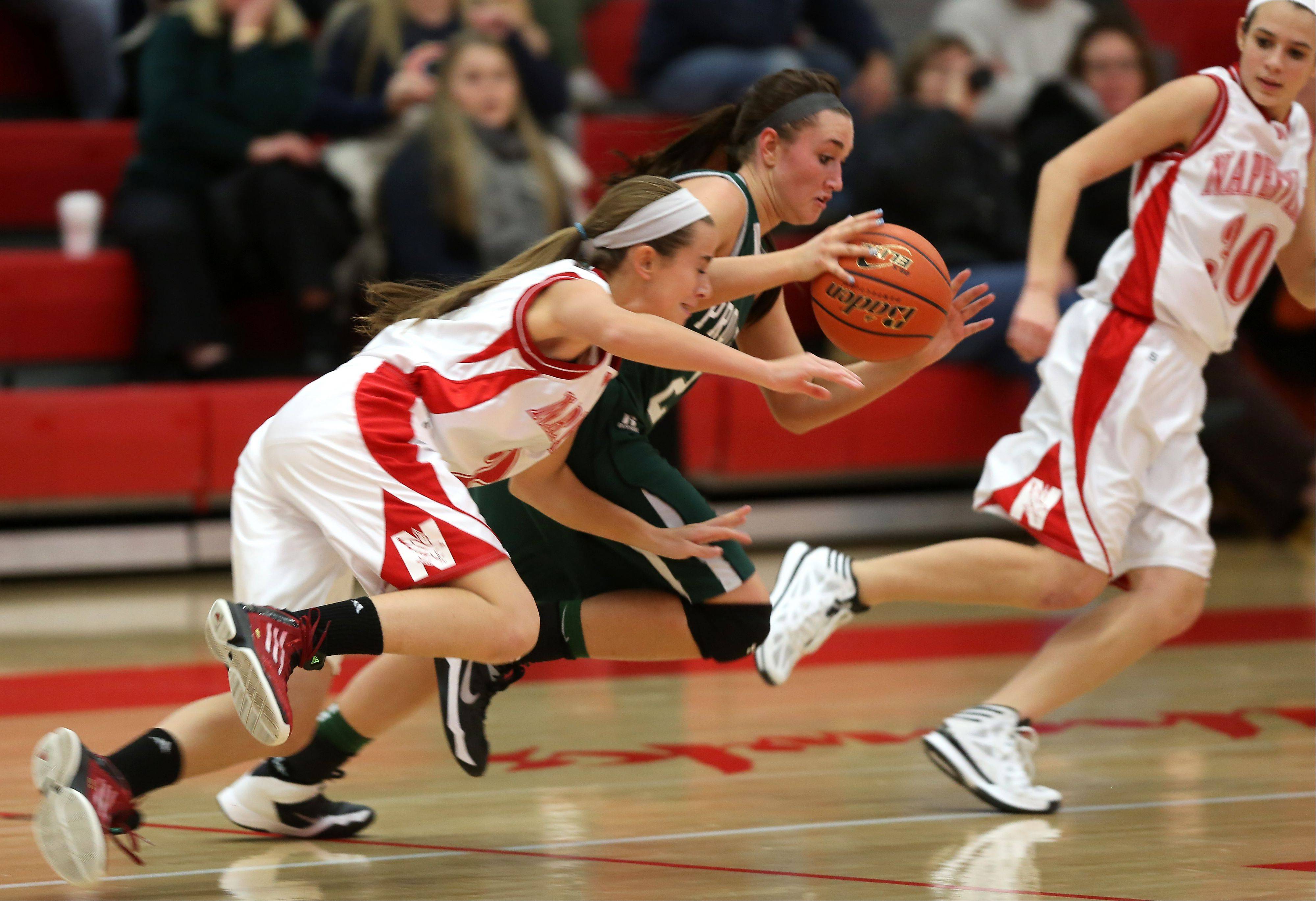 Naperville Central's Courtney Giebel, left, battles Providence's Alyssa Jurges during the 2013 girls basketball Tip-Off Tournament.